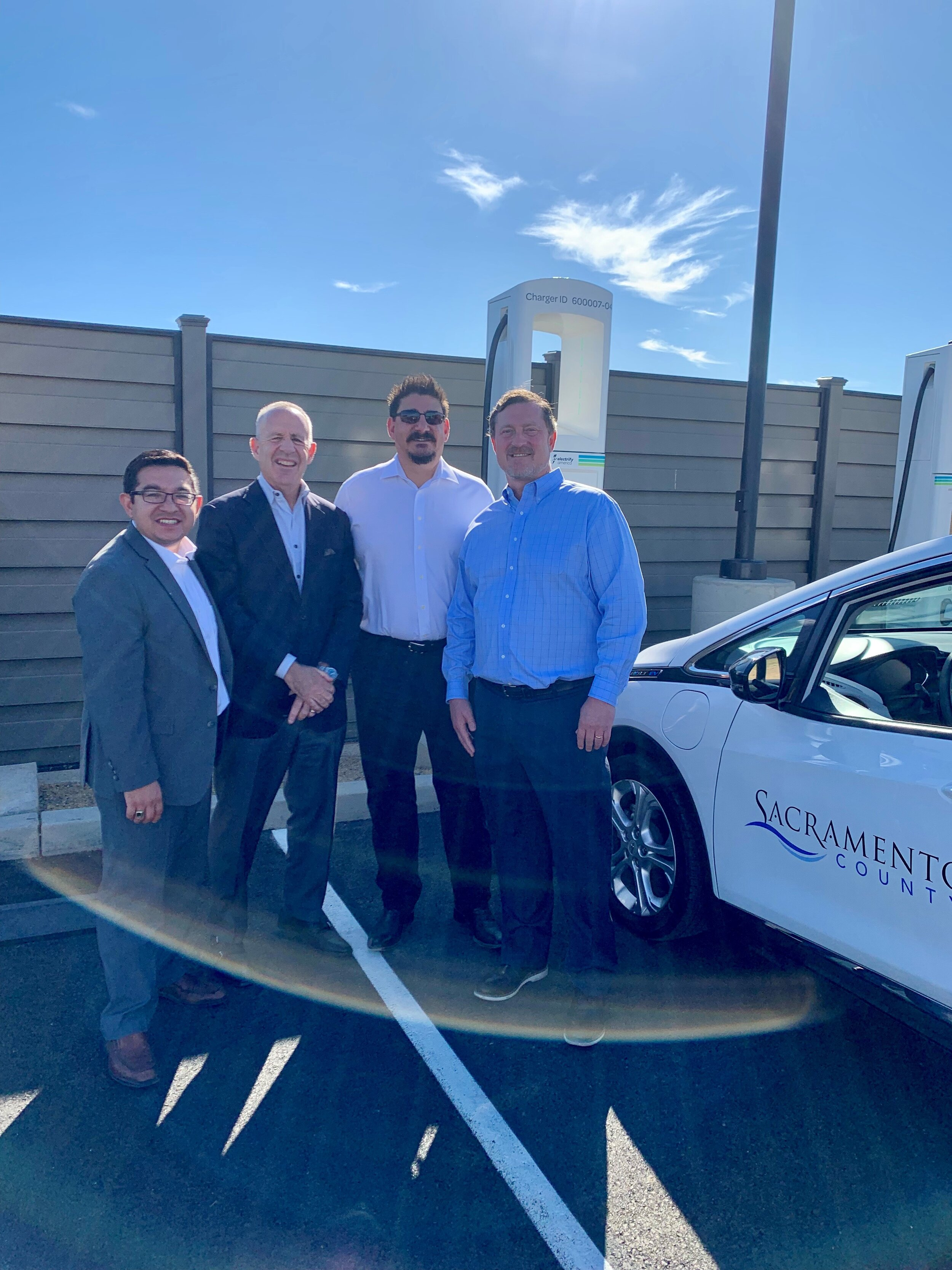 From left: Councilmember Eric Guerra, Mayor Darrell Steinberg, Supervisor Phil Serna and Electrify America's Will Berry.