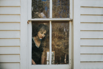 Window portrait of Kelsey Johnson by fine art portrait photographer Jaclyn Le