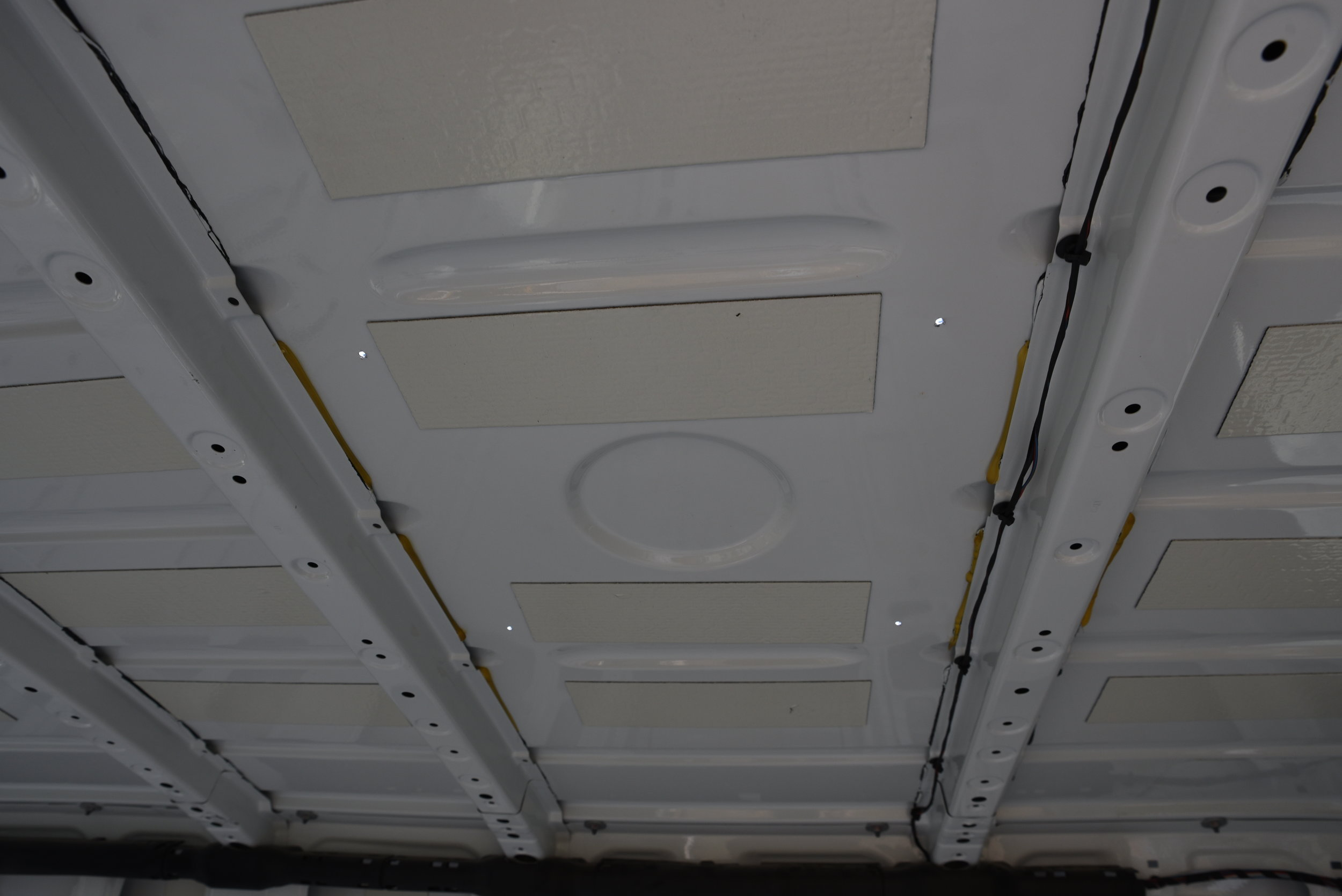 You can see the four corners of our fan drilled into the ceiling in this picture.
