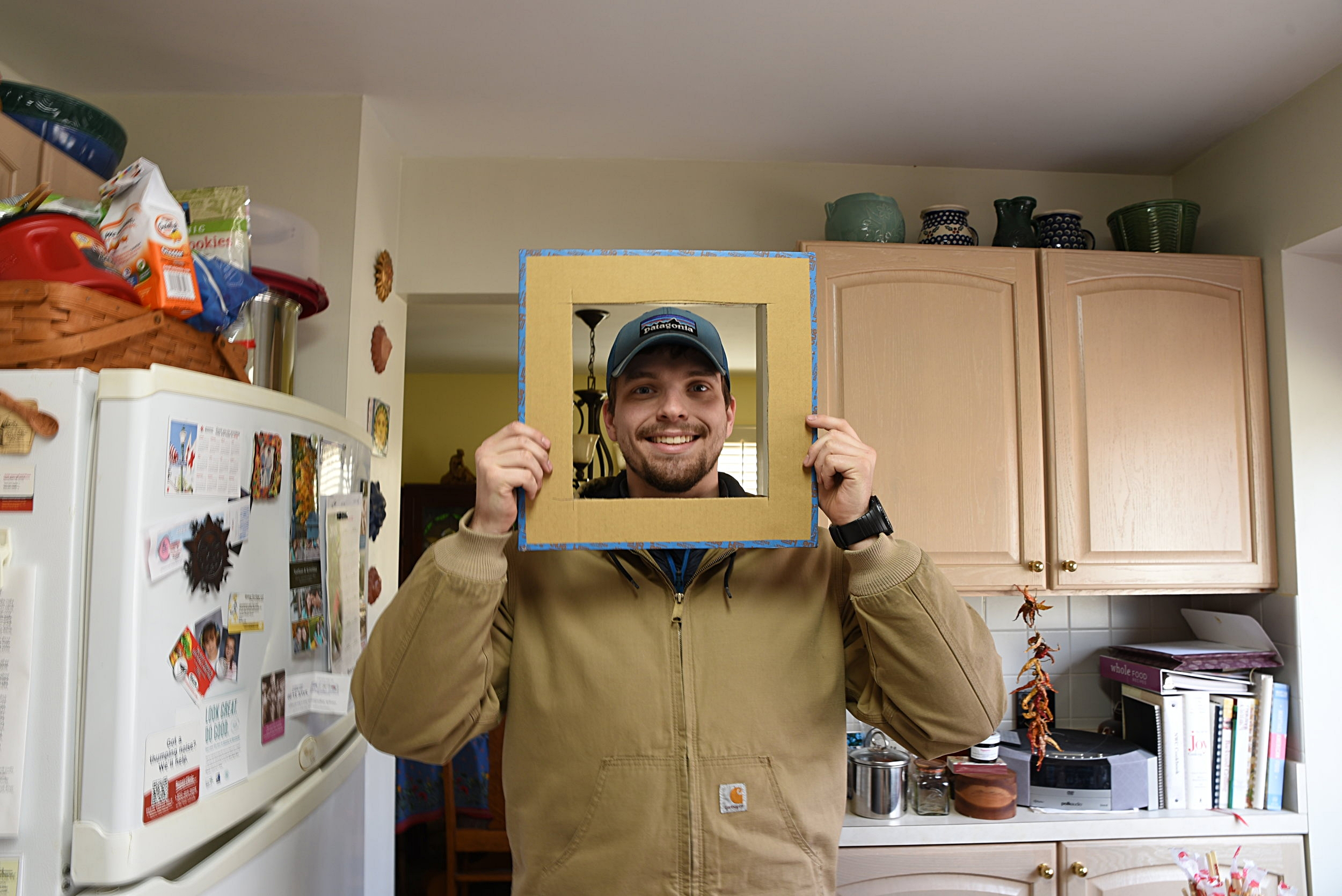 Ian poses for a photo with his cardboard template.
