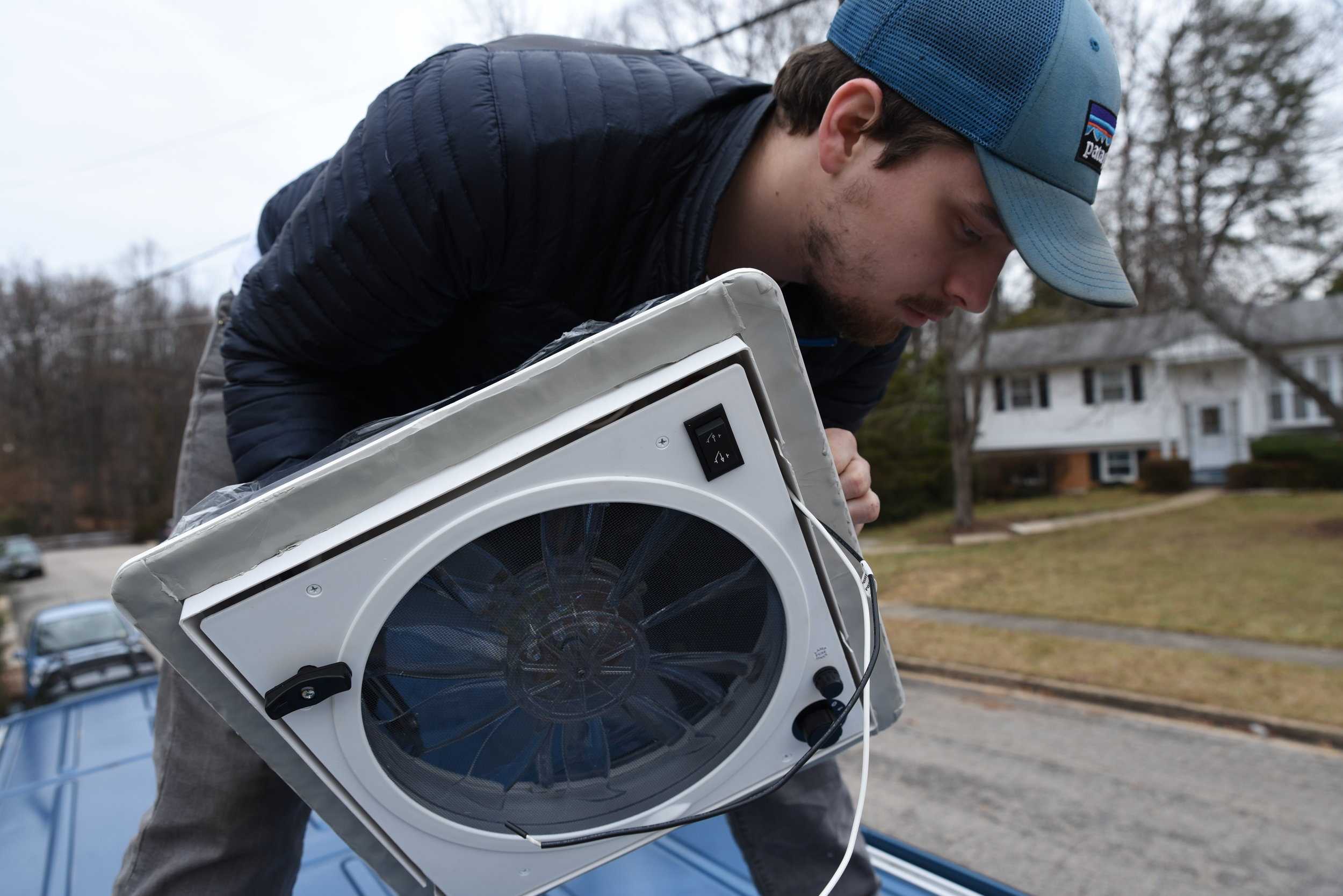 Ian installs the Fan-Tastic Vent with the butyl tape on the bottom of the vent's flange.