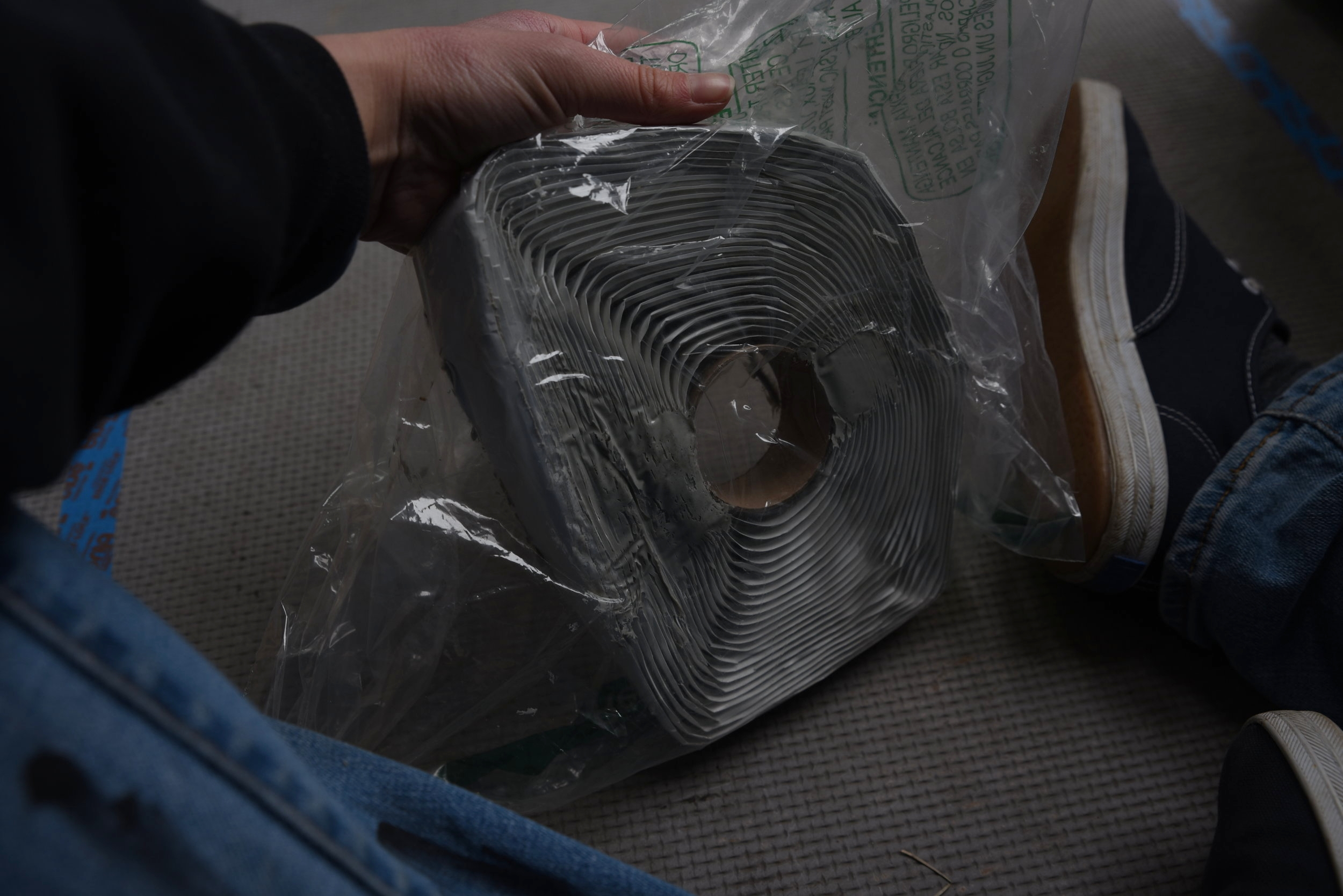 Butyl tape is a really stick putty like tape that will hold your fan in place and create a seal against the van.