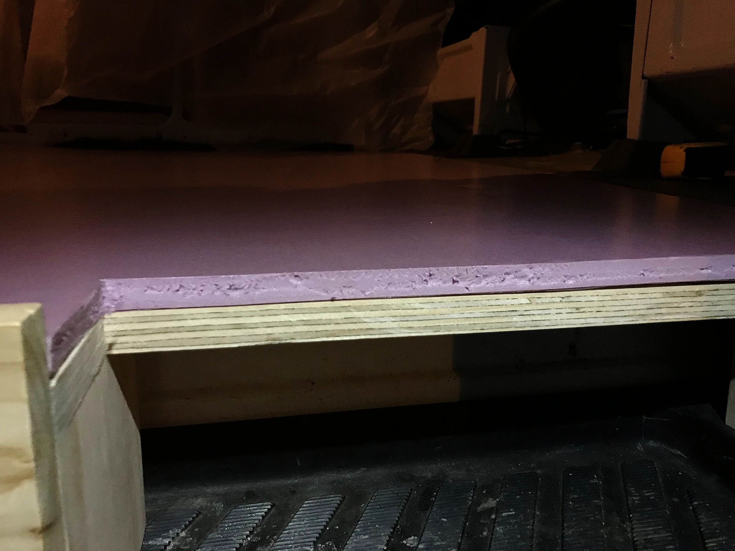 Adding a half inch of XPS will keep our feet warmer without losing too much headroom. Here is a view of the floor foam cut out for our step area.