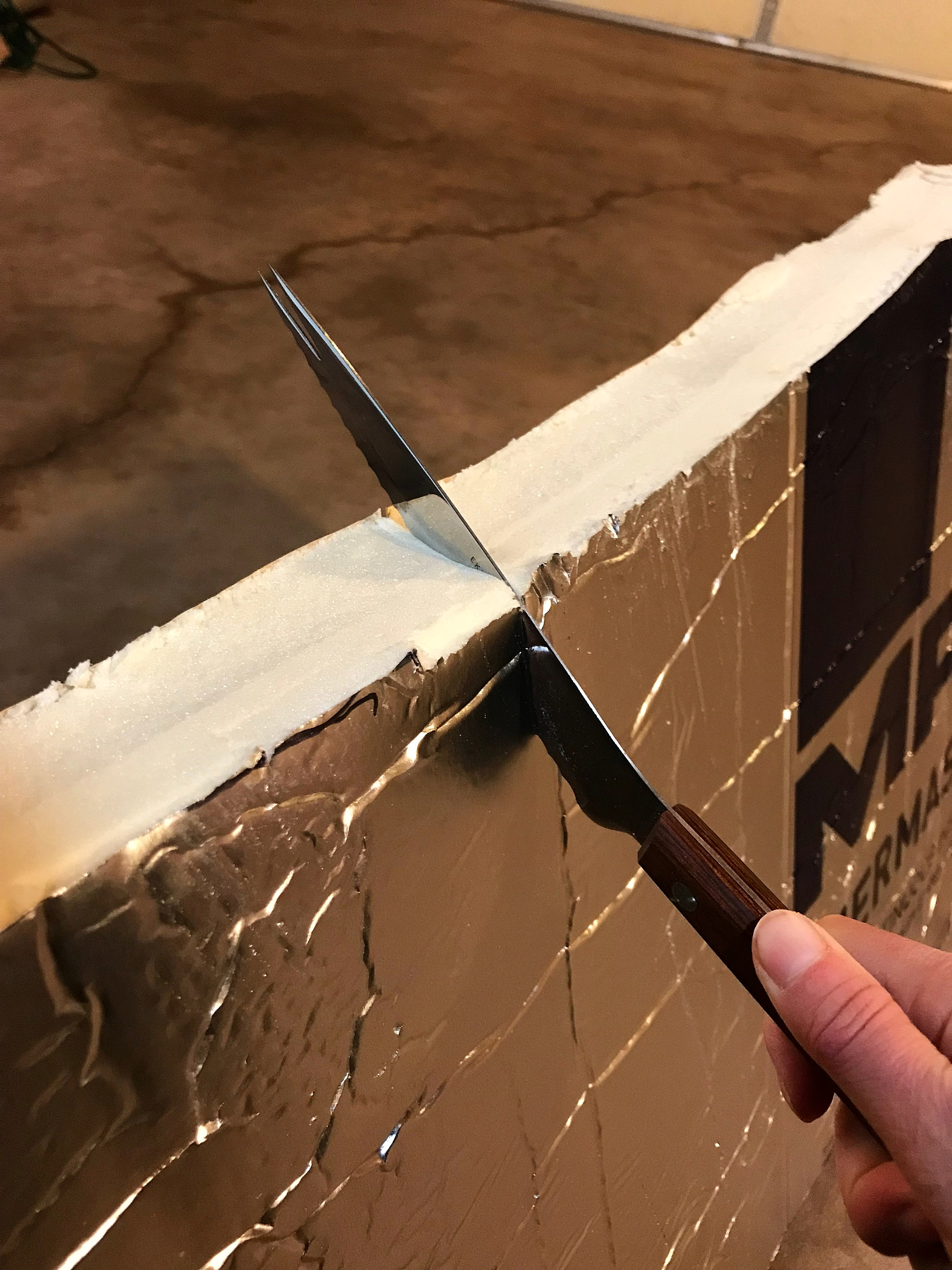 We used this old tomato knife and a larger bread knife to cut the polyiso insulation.