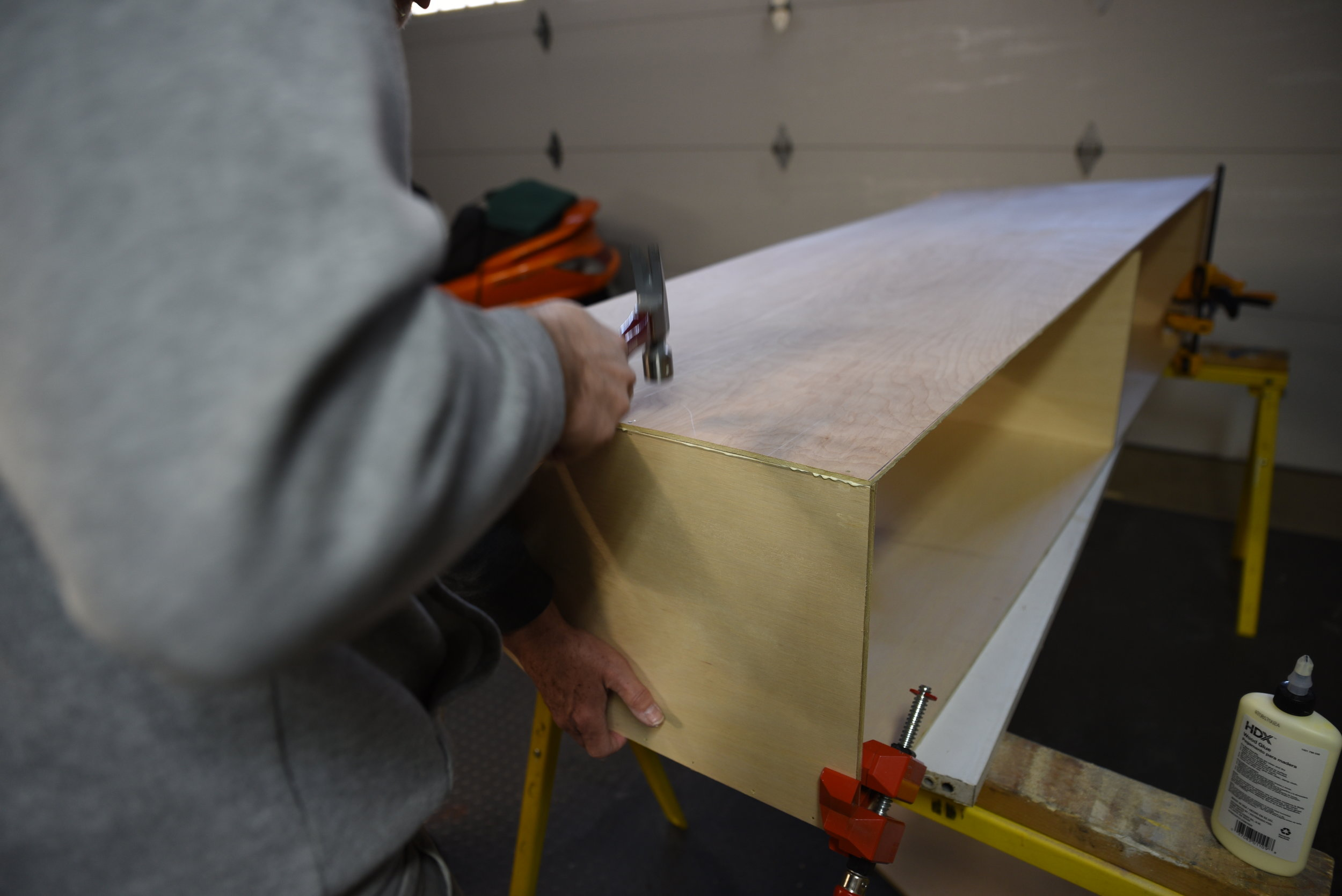 Ian joins the 1/4 inch cabinet back to the 1/2-inch plywood uprights.
