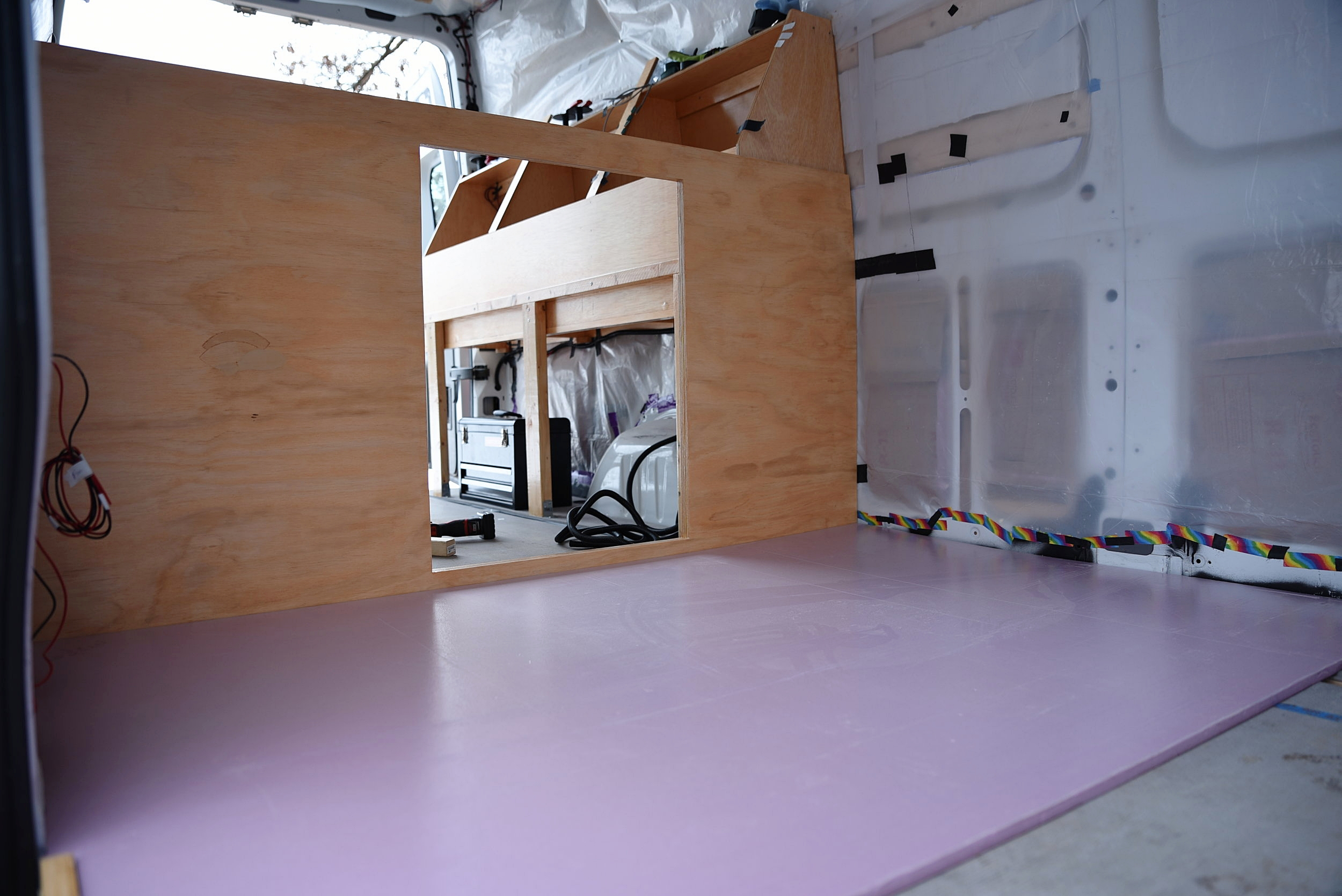 The front of the bed platform front ready to receive the double-hinged cabinet door.