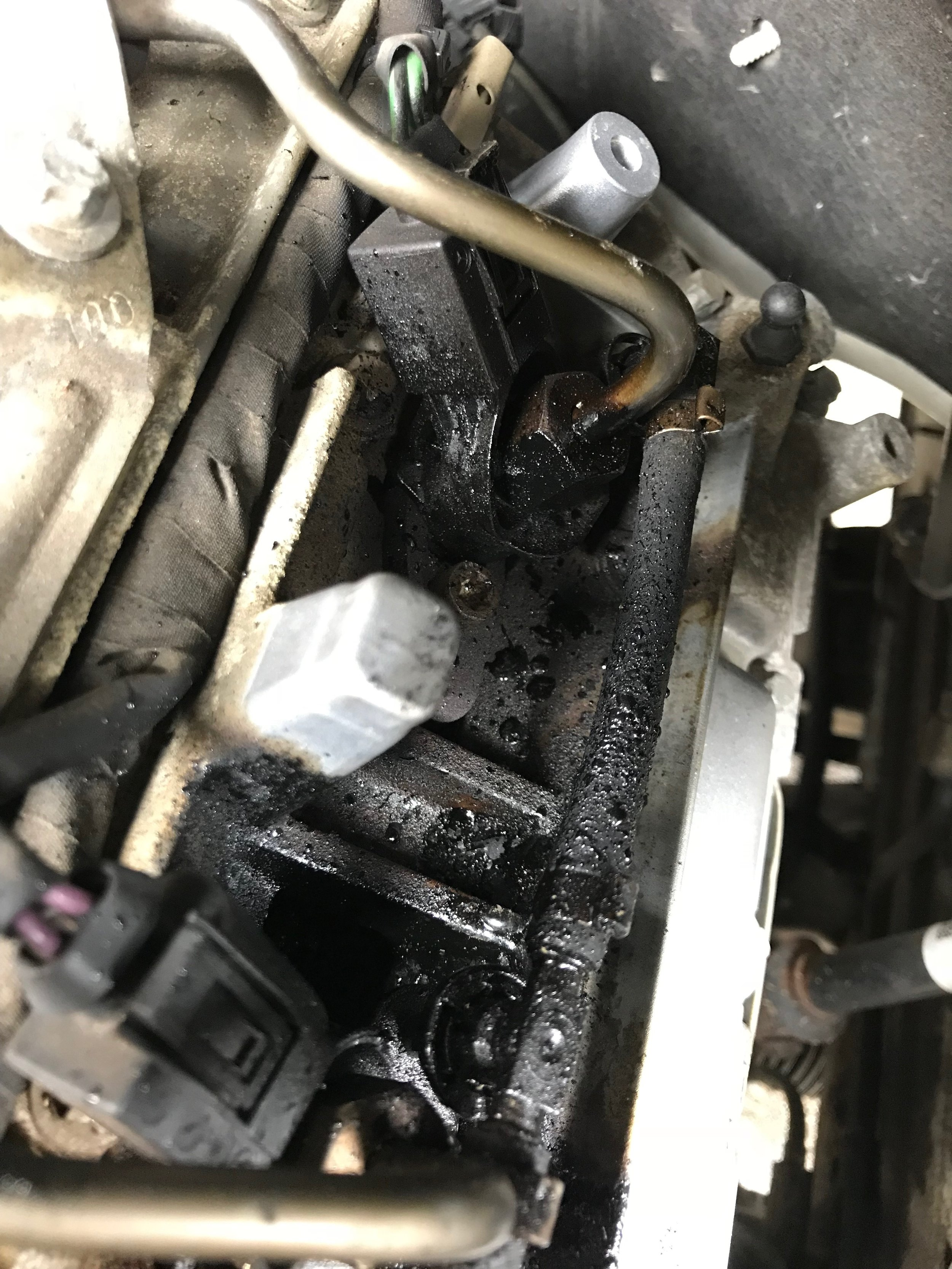 The black gunk was apparent around the injectors and along with the chuffing, we were certain it was Black Death.