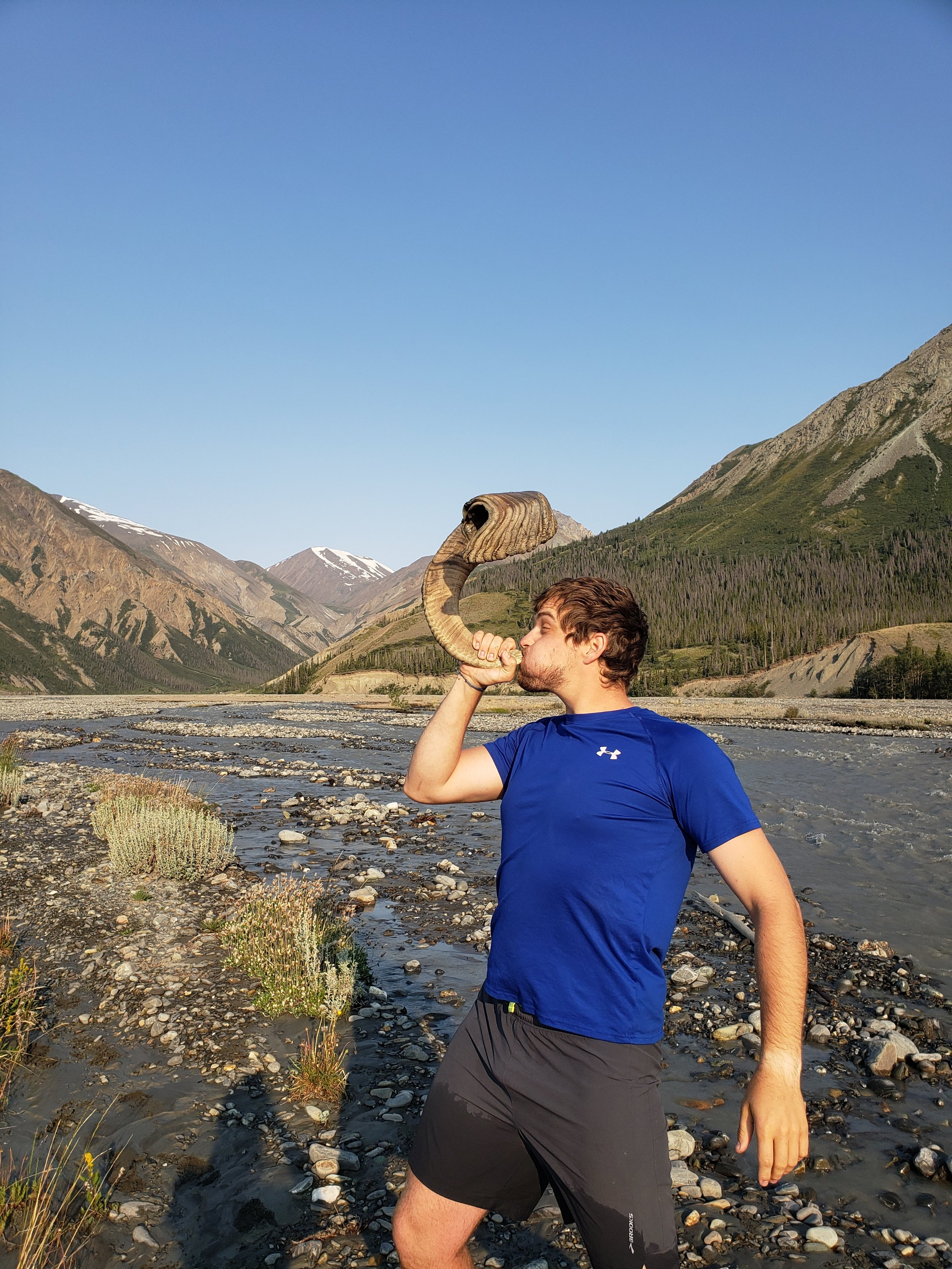 Ian sounds the horn of triumph after crossing the high water on Canada Creek. He actually put his mouth on it!