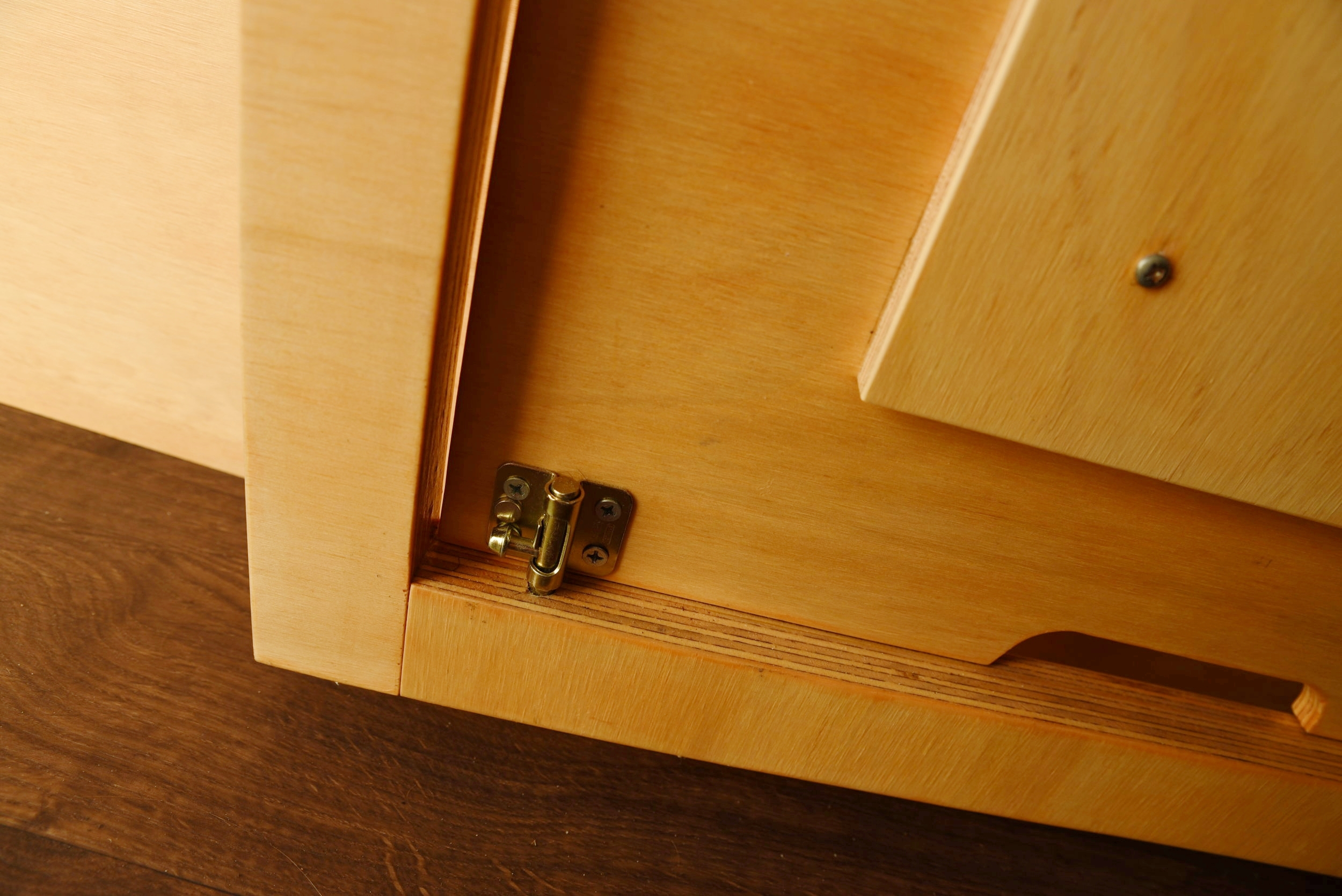 A simple slide lock on the back keeps our table from smacking about while we drive.
