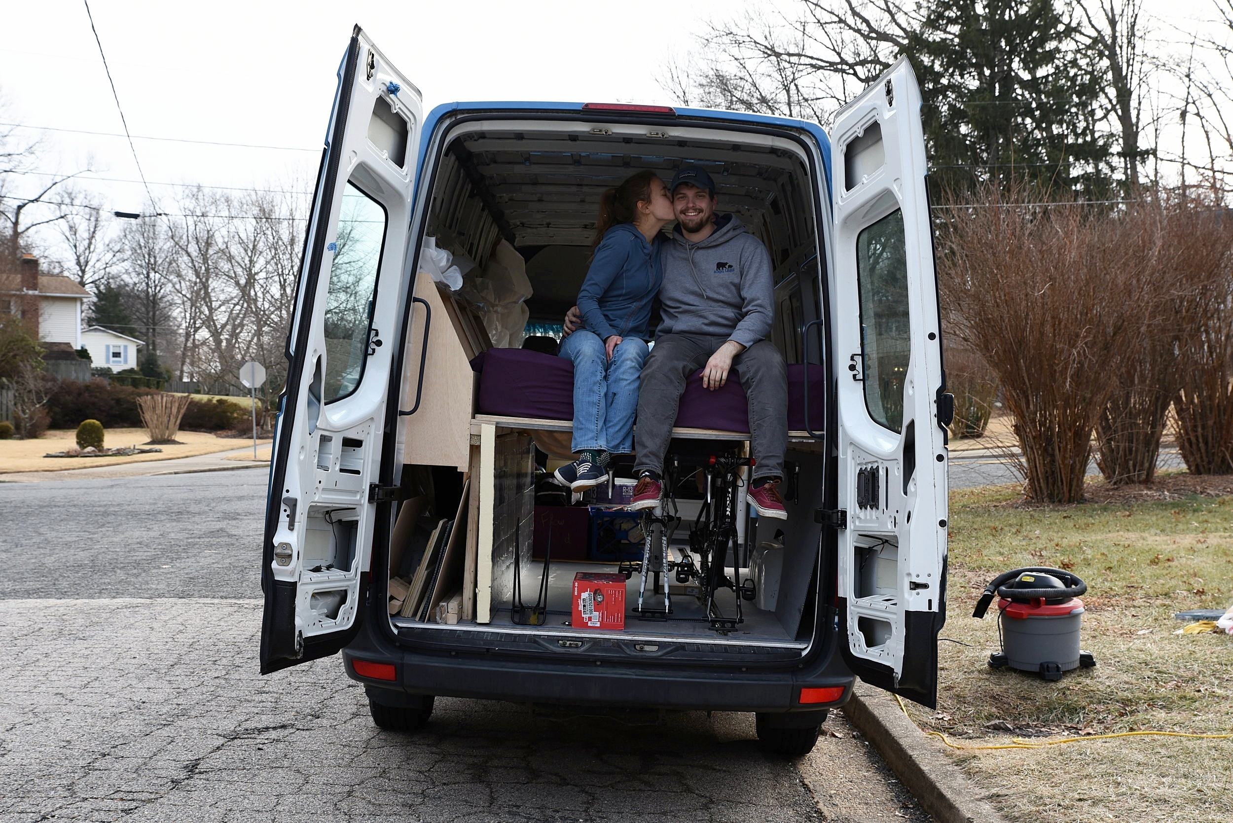 With the bikes in place under the bed platform, large storage areas on the driver's side, and our mattress on top, we were pretty satisfied with our work.
