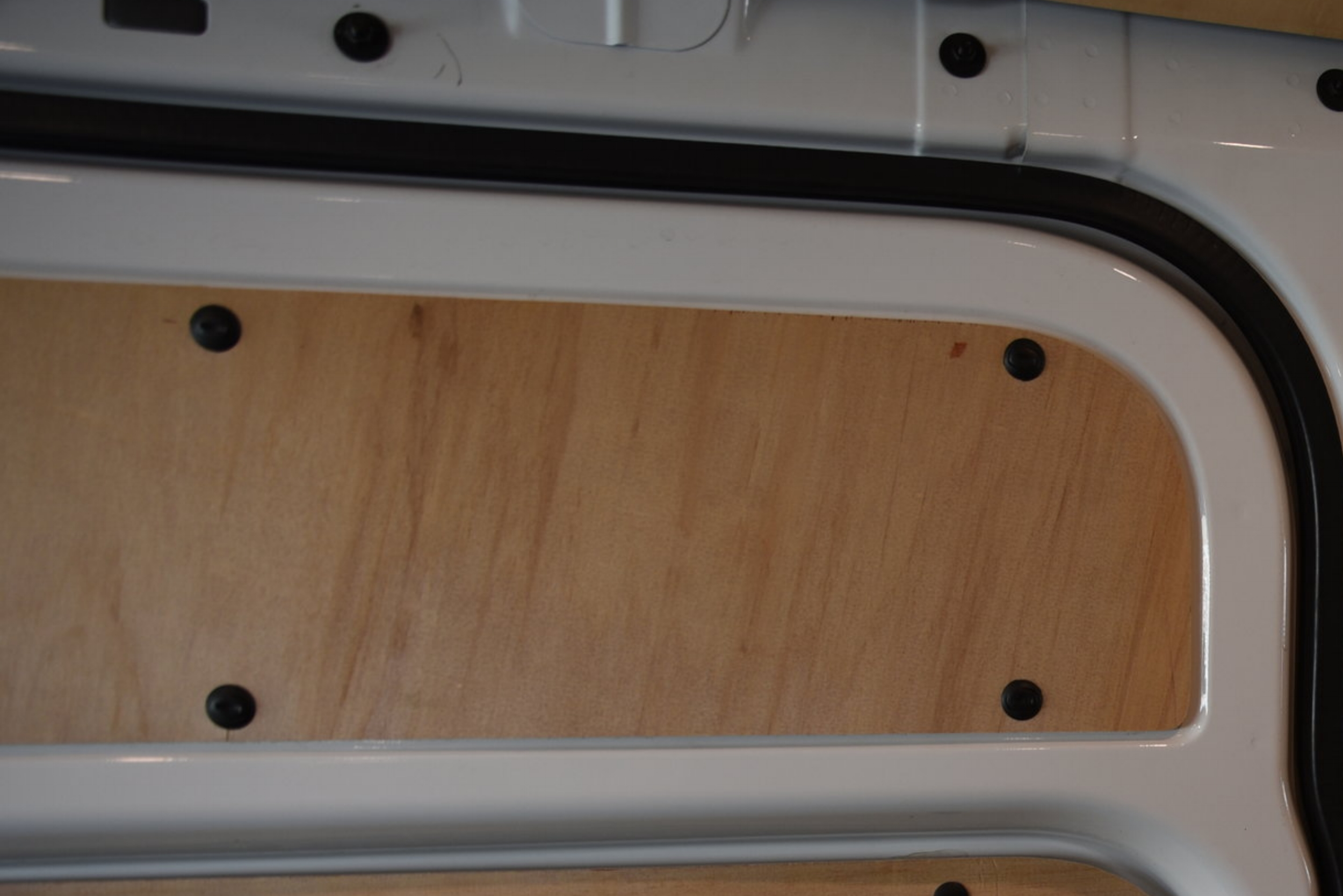We used the same plastic clips from the doors' original plastic panels to attach the wood panels.