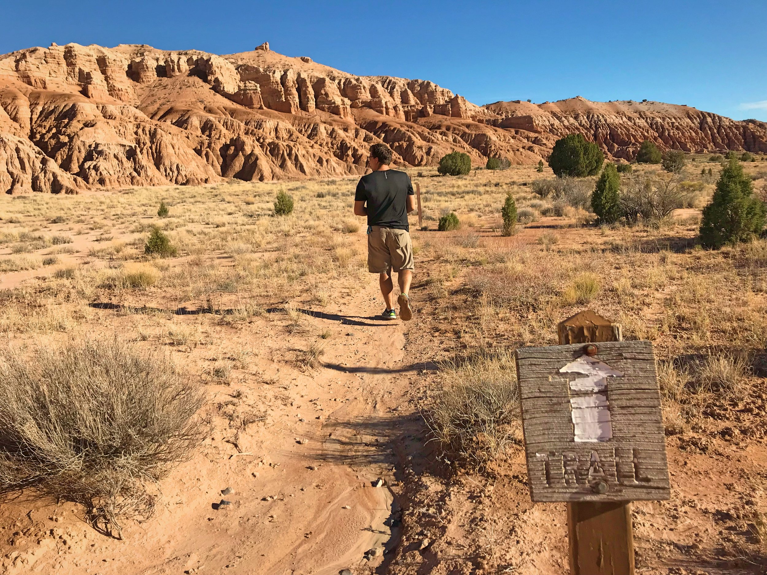 Ian walking on Juniper Draw trail. There is no shade at all on the trail.