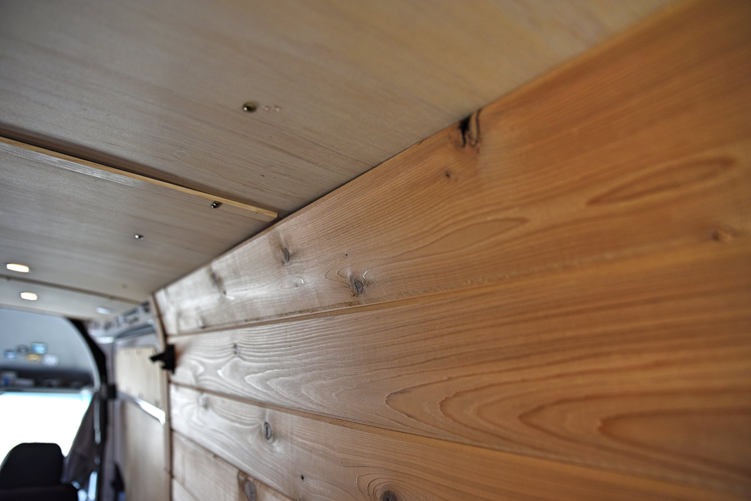 The angled piece of tongue and groove at the top of the walls echoes the curve of the ceiling.