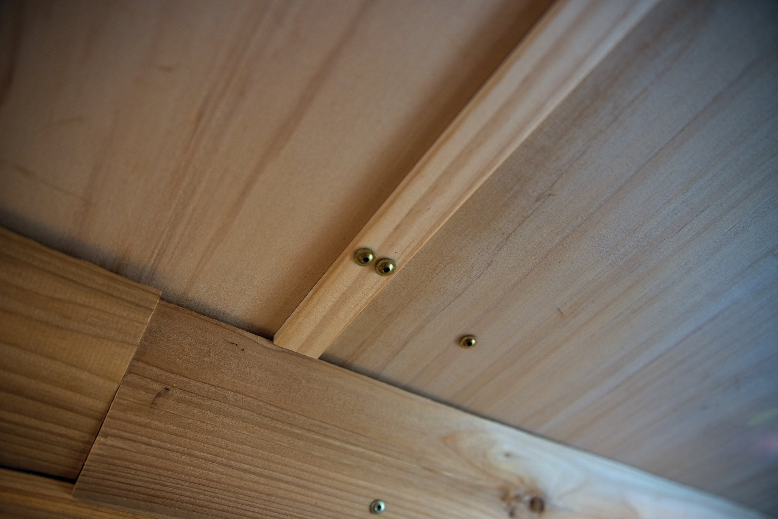 We put the screws in pairs, one into each ceiling panel, lining them up with the pairs in the other pieces of trim for a uniform look.