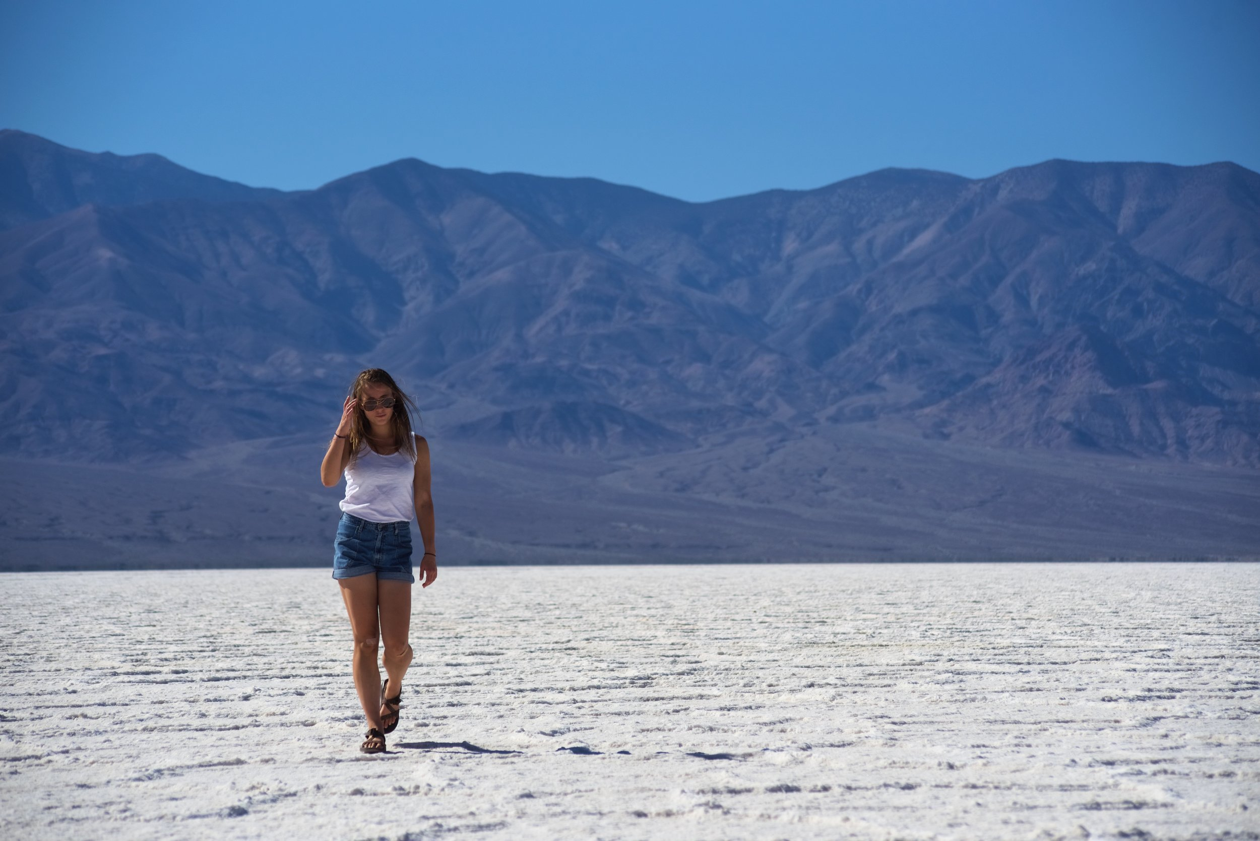 Walking on the Badwater Basin salt pan is actually pretty challenging because of the extreme heat, even though it's perfectly flat.