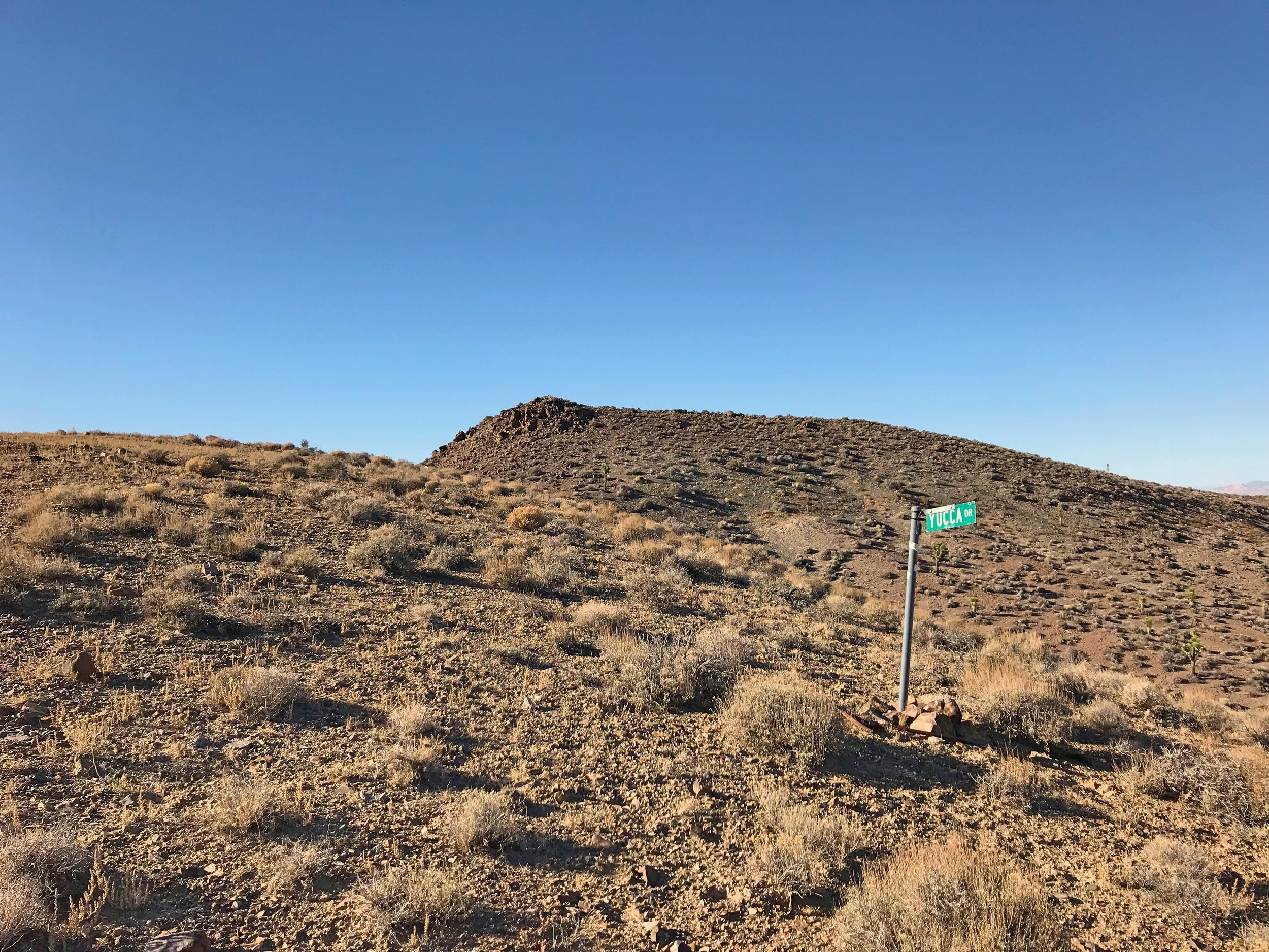 We spotted this random road sign for Yucca Dr. on top of a ridge nowhere close to a road while we were running around the International Car Forest.