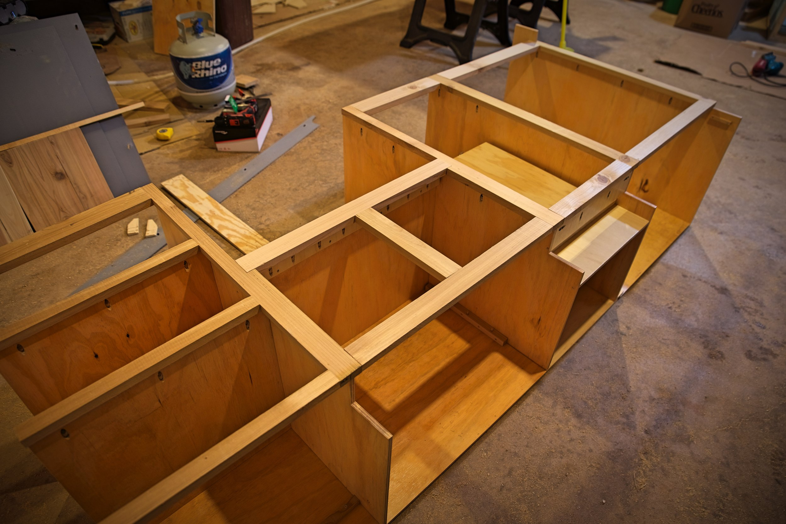 Eventually the frame would be joined to the cabinet cases using the pre-drilled pocket holes you can see all over this photo.