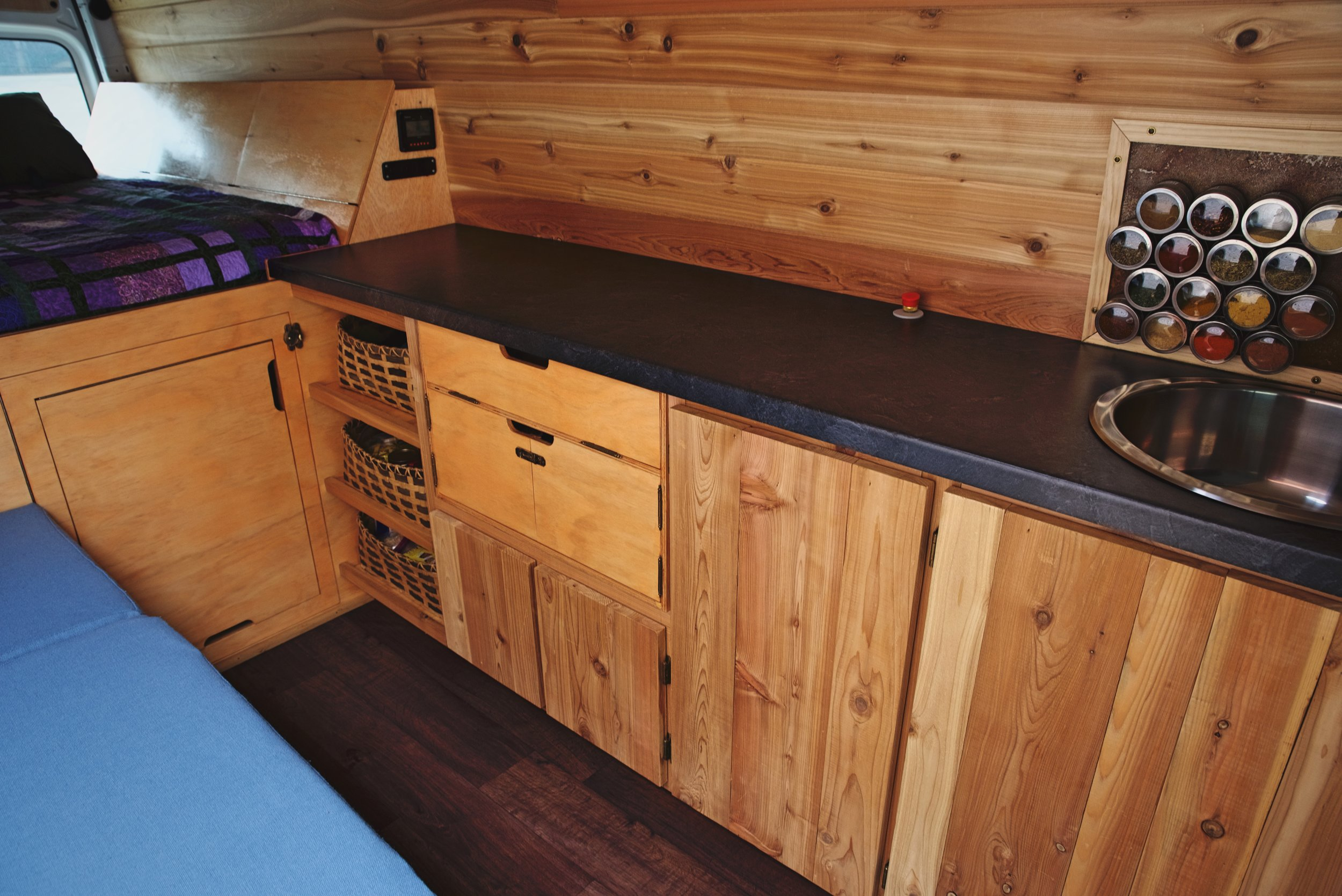 Building our cabinets was one the more complex elements of woodworking in our van. We built and designed the cabinets with the items we would be storing in mind.