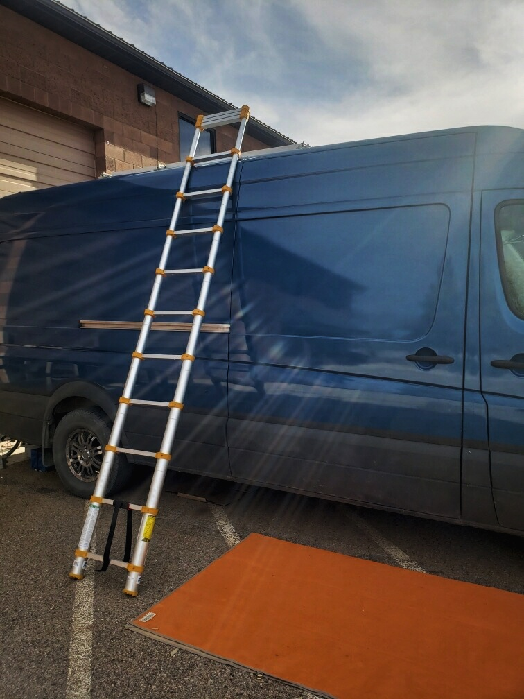 The ladder extends to 12.5 feet, so we can easily get on top of our van whenever we need to clean our solar panels.