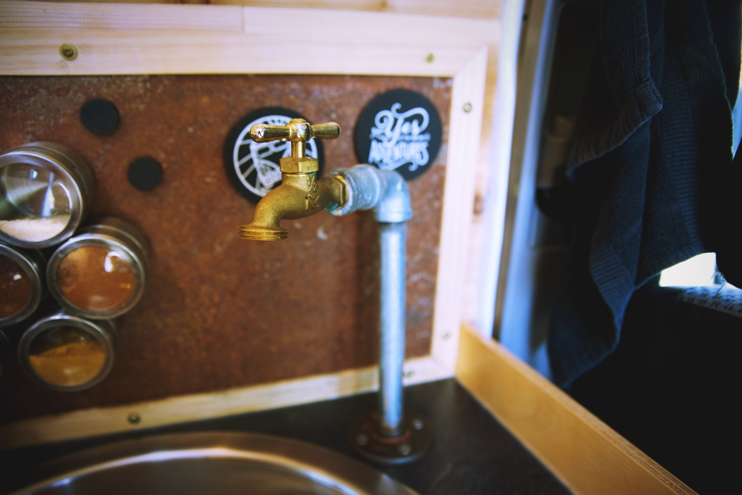 The finished faucet was both affordable and it matches the rustic look of our van's interior.