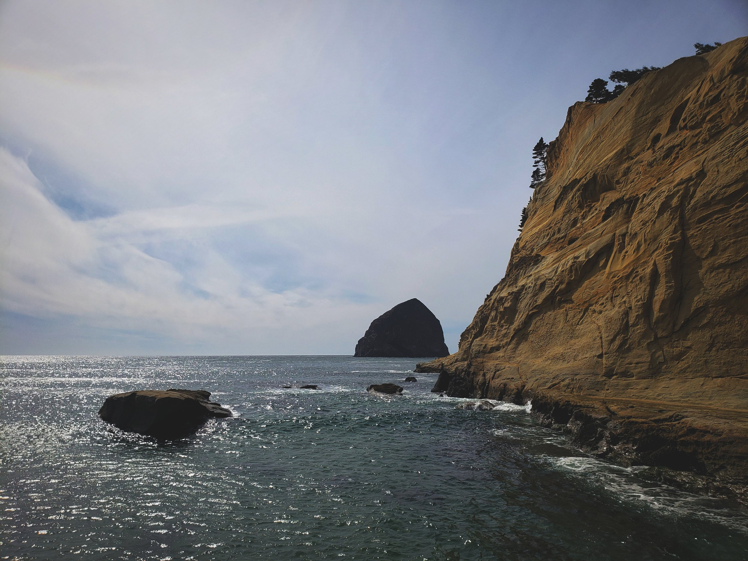 Haystack Rock has protected the soft sandstone cliffs of Cape Kiwanda from wave action while other areas have eroded completely.