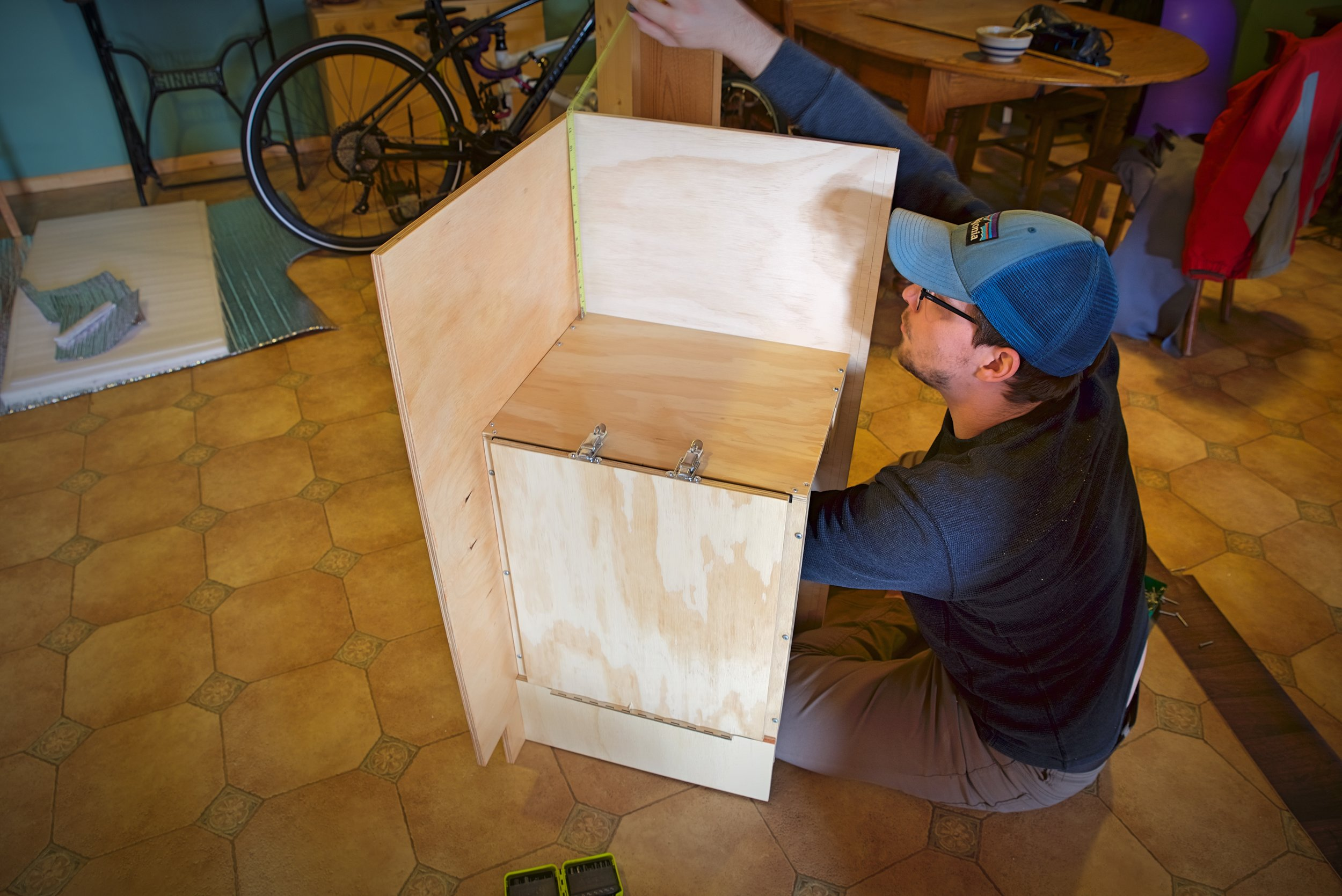 The door is inset from the walls of the larger cabinet, because it needed to be able to swing open within the face frame of the cabinet.