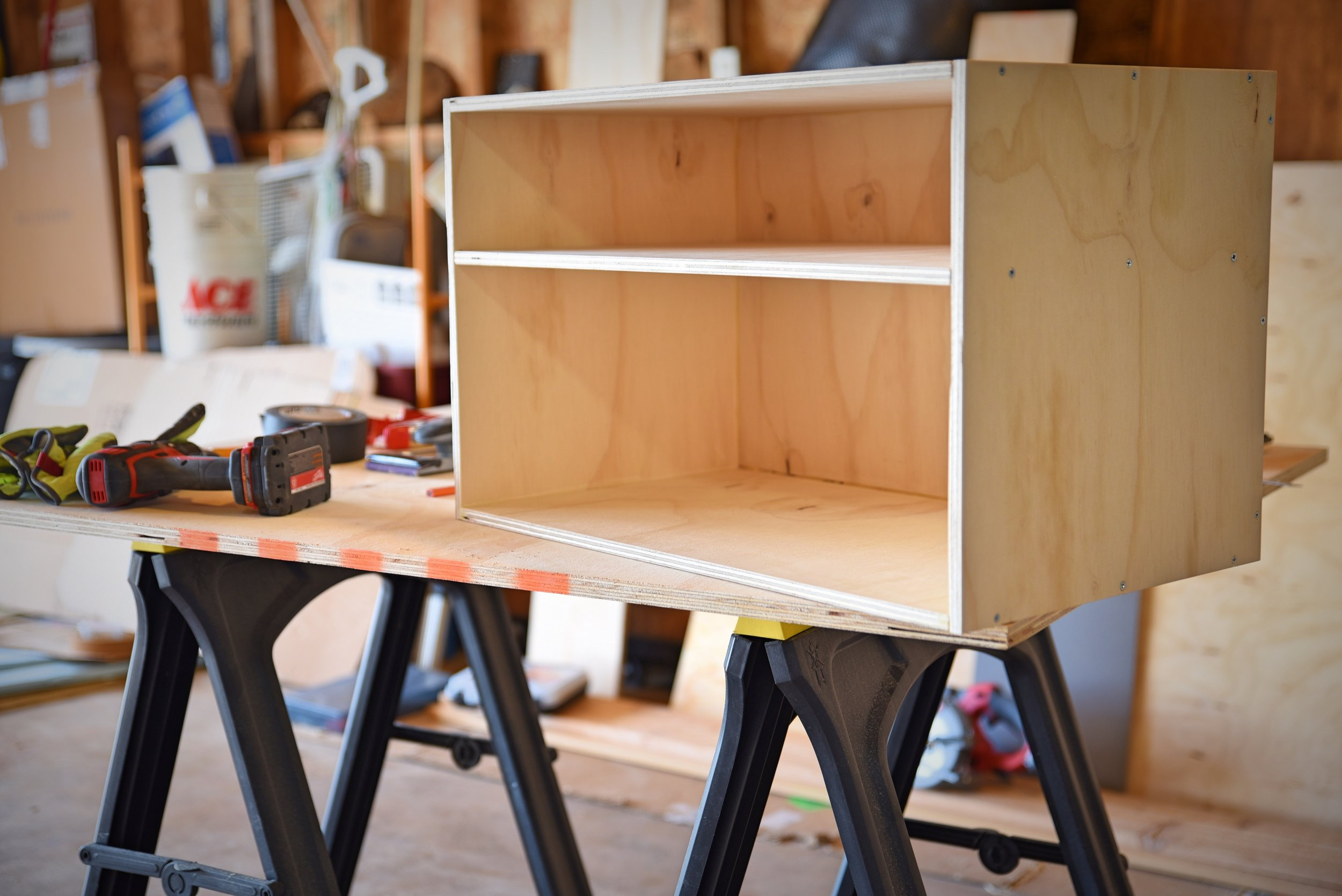 Our chuck box is a very simple plywood box with two sections and hinged doors. It's screwed together with countersunk screws and reinforced with wood glue.