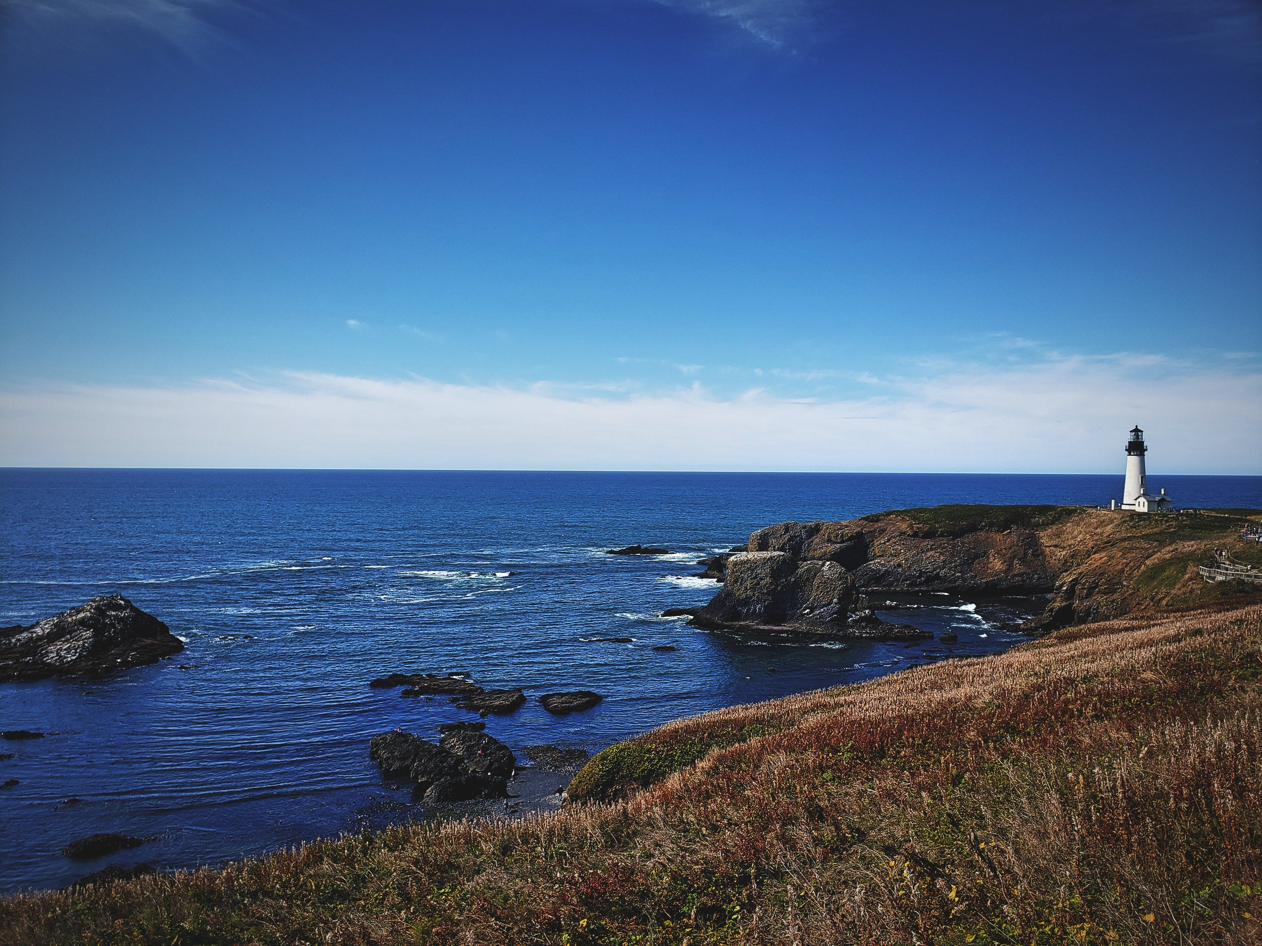 The Yaquina Head Lighthouse is at the tip of the basalt headland that sticks out into the Pacific a mile.