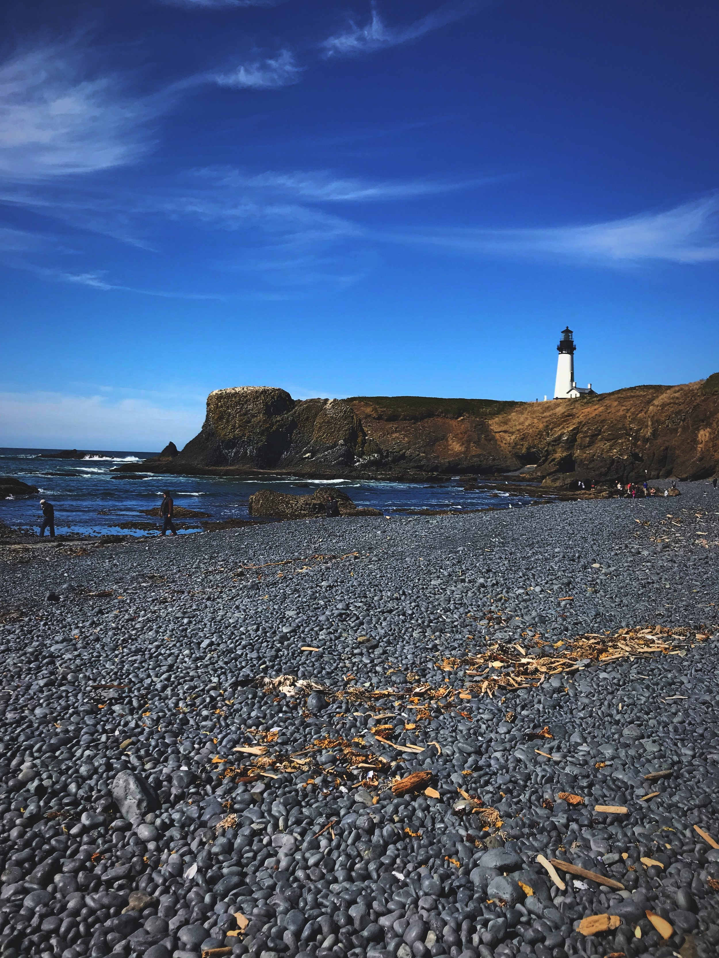 The view of Oregon's tallest lighthouse from the cobble beach.