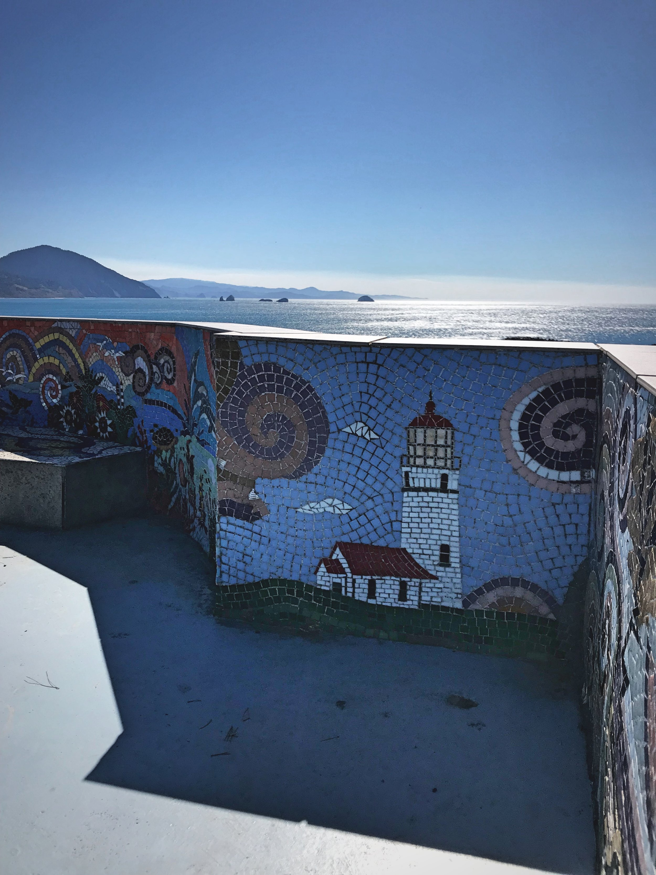 We spotted this mosaic depiction of the Cape Blanco lighthouse in Port Orford, Oregon.