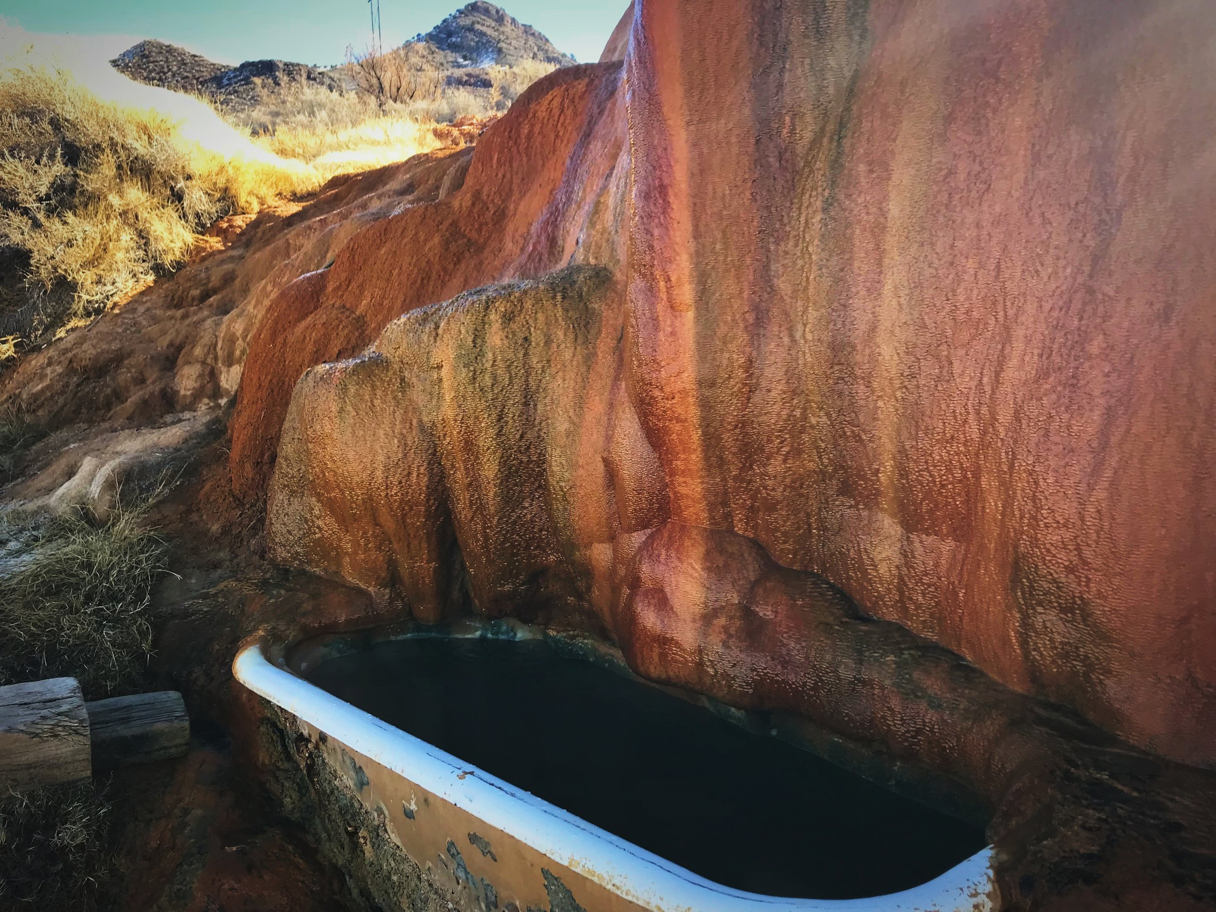 The water runs over the mineral and into the pools.