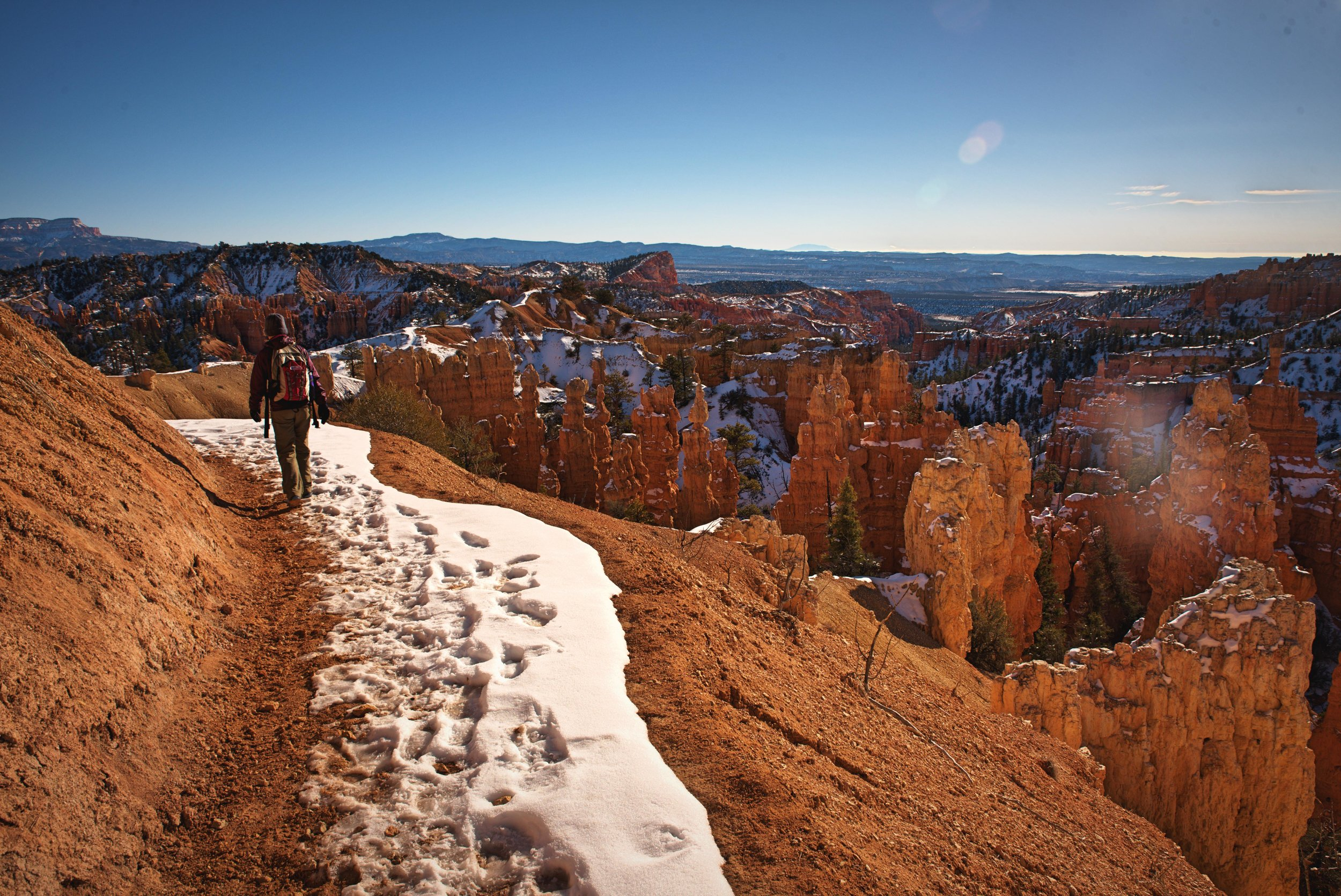 You descend into Bryce Canyon at Fairyland Point. This portion of the trail is a ledge with a sloped drop off next to it.