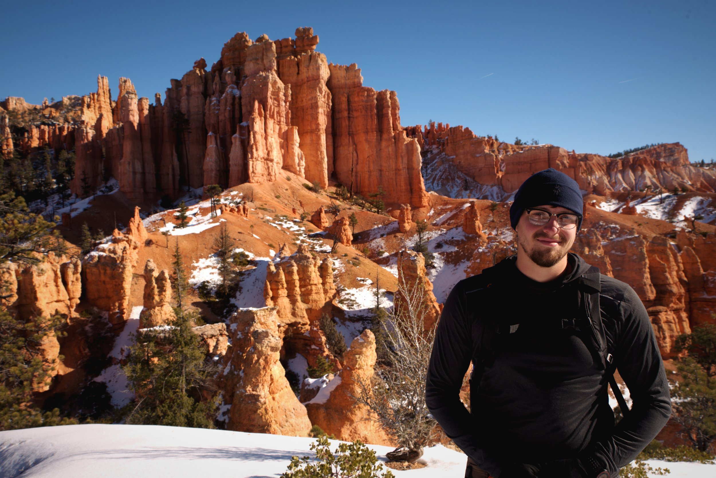 Ian stands in front of some incredible hoodoos in Fairyland Canyon.