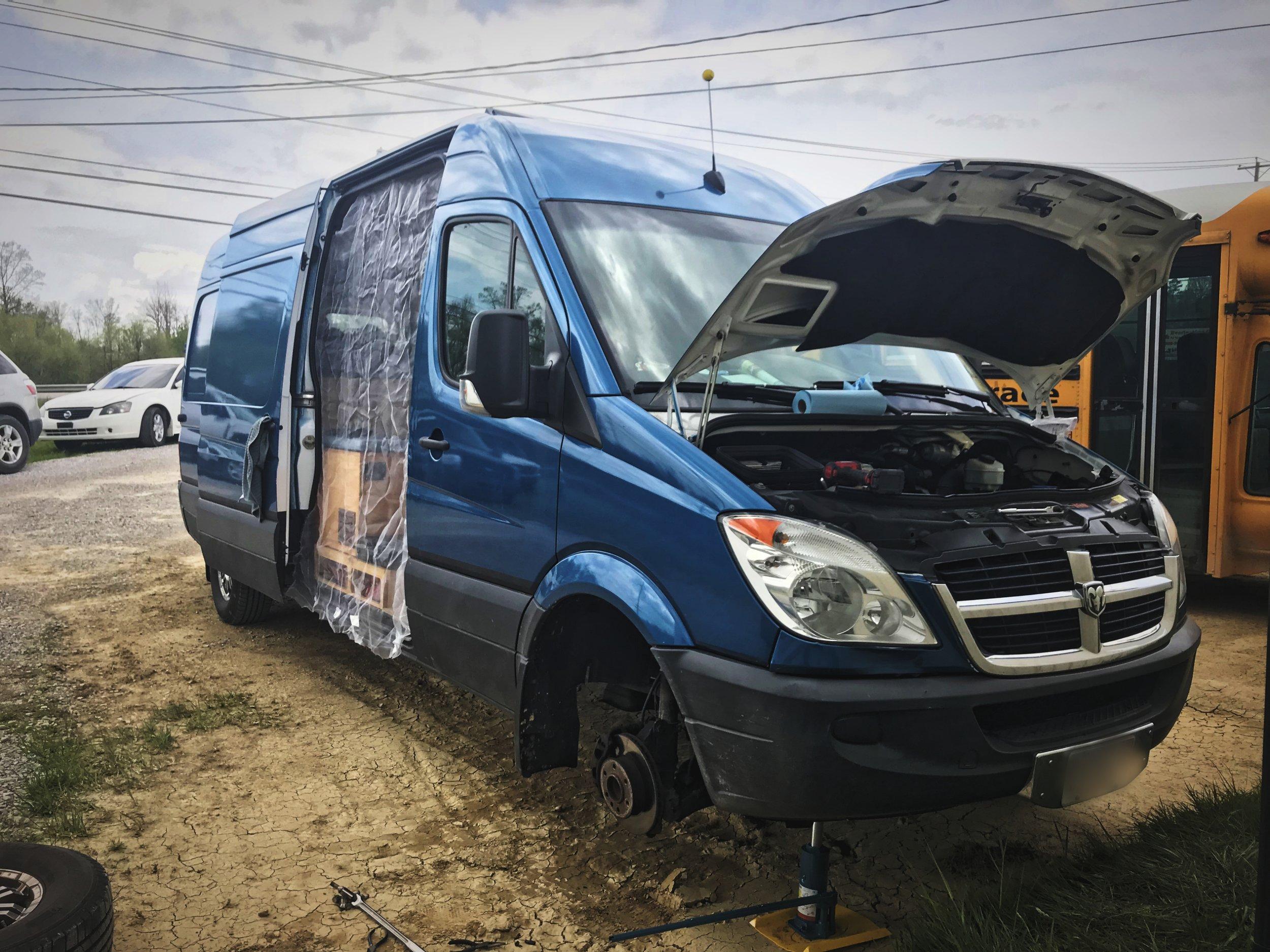 Ian repairing our van while we were in Kentucky.