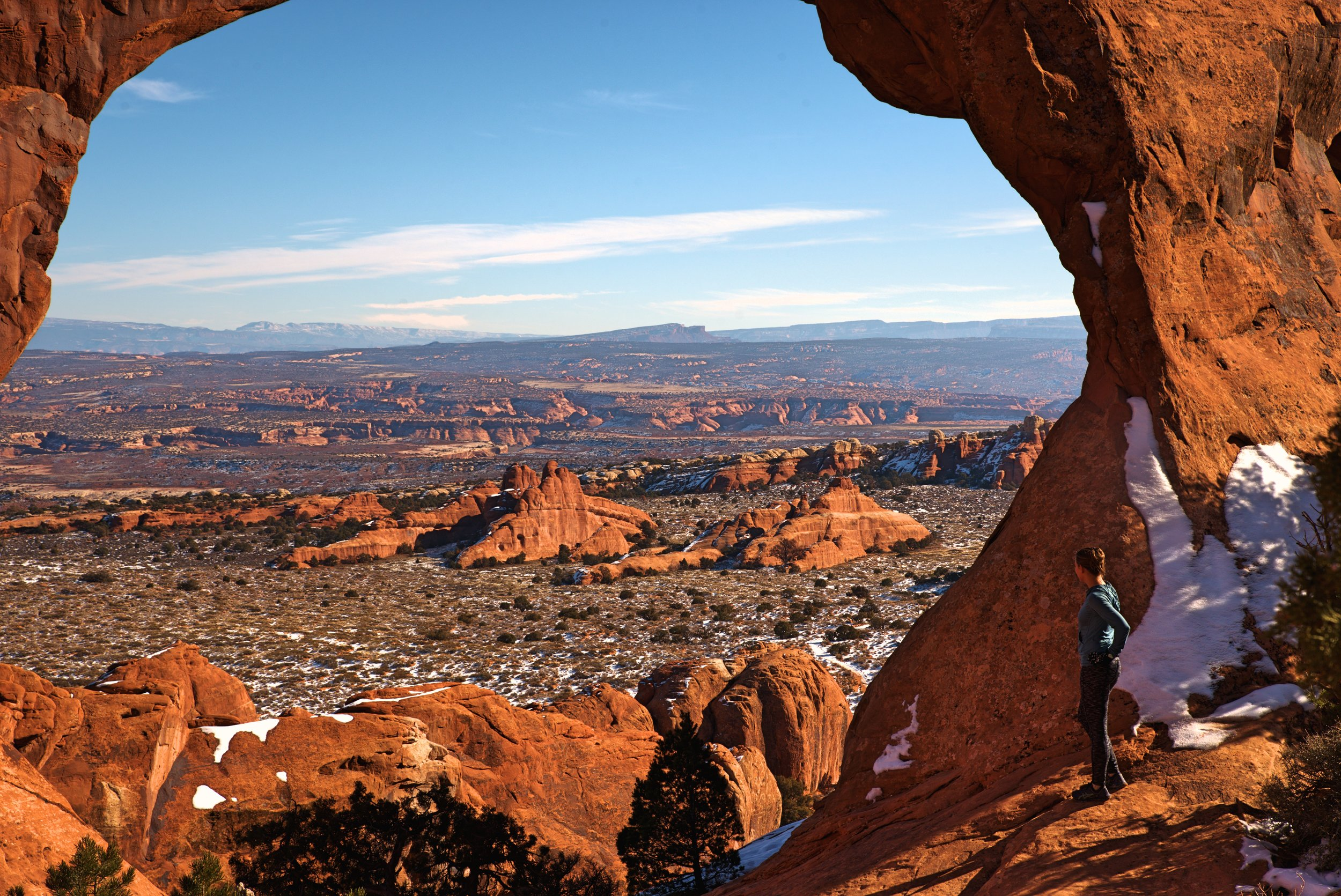 Looking out over the grand vista of Arches National Park framed by Partition Arch.