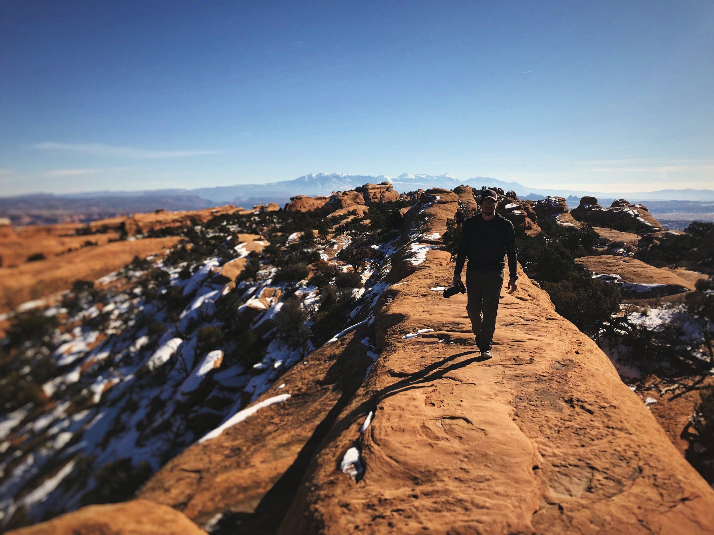 Ian walks on a sandstone fin on the Devils Garden trail.