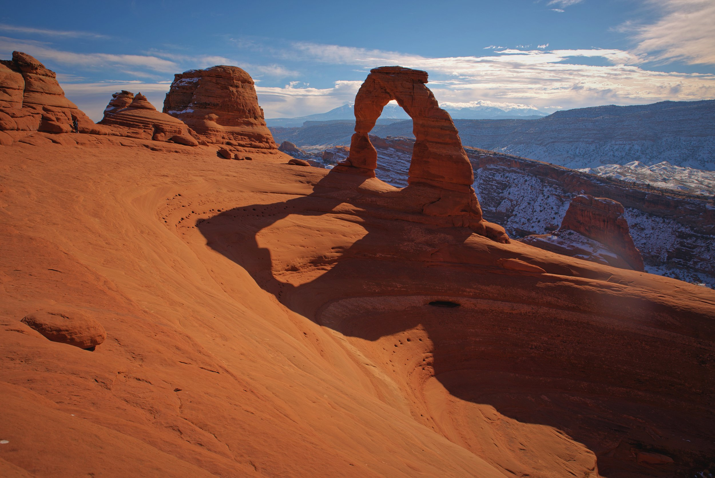 Delicate Arch sits atop an immense and impressive sandstone bowl.