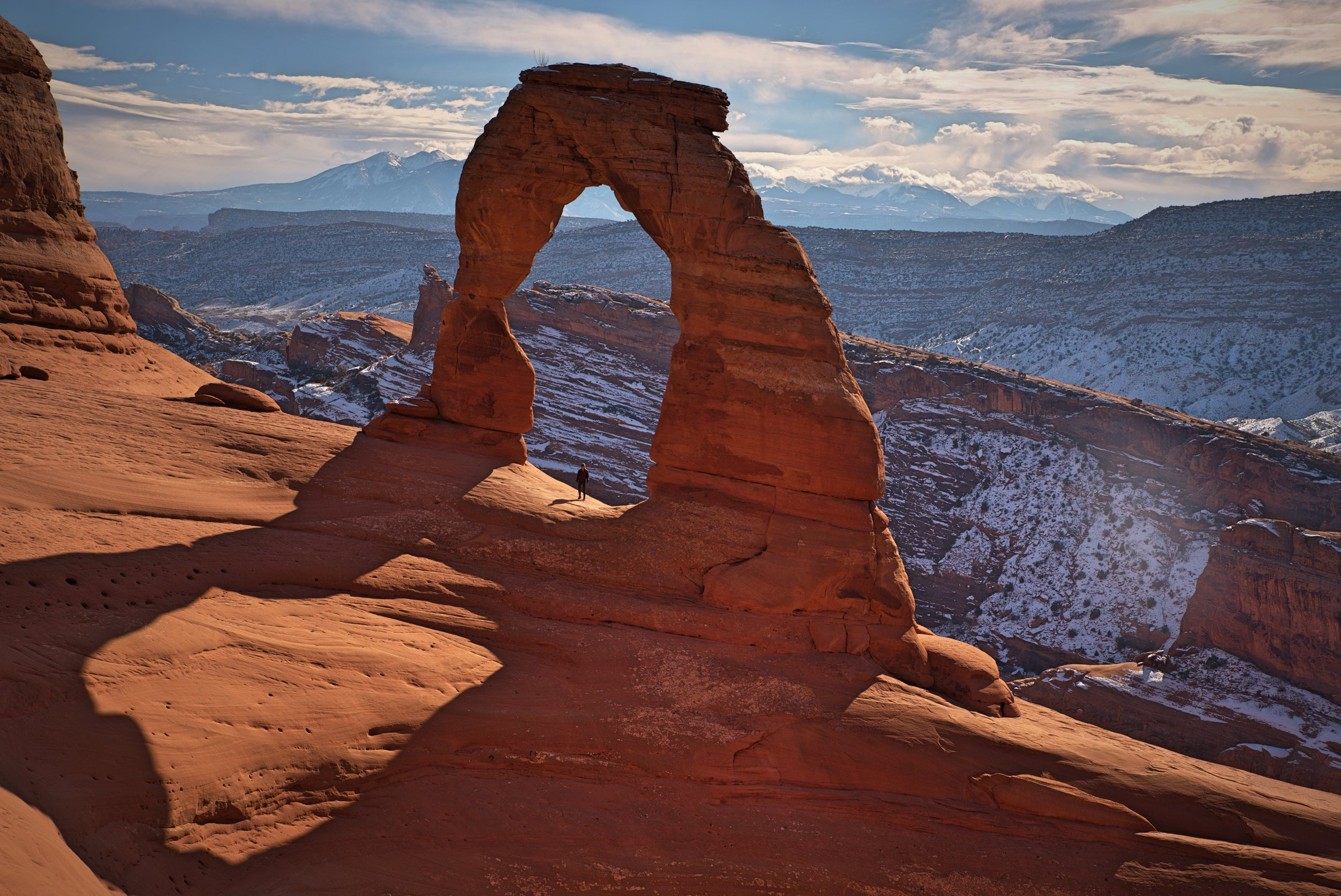 Delicate Arch is huge—you can see Kaylee as a tiny figure under the arch.