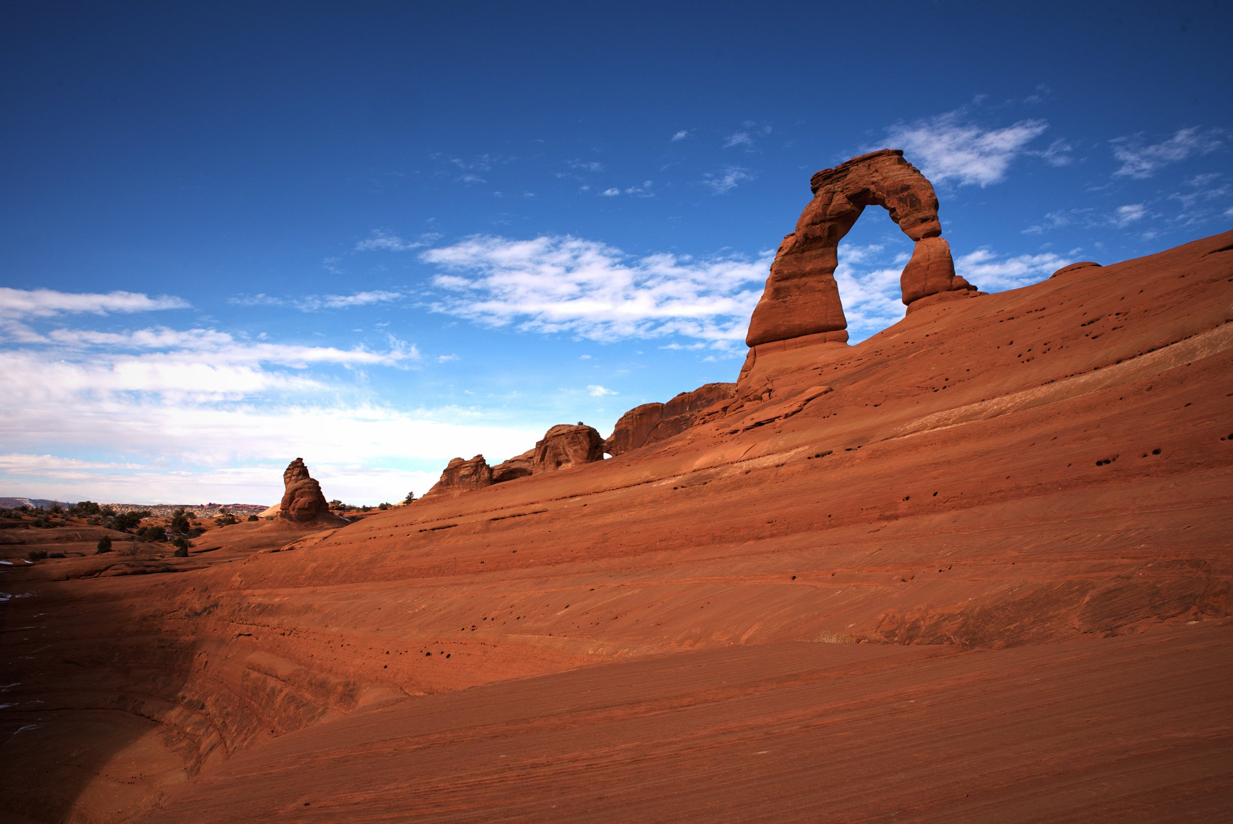 Ian climbed down behind the arch to snap this picture of Delicate Arch from another angle.