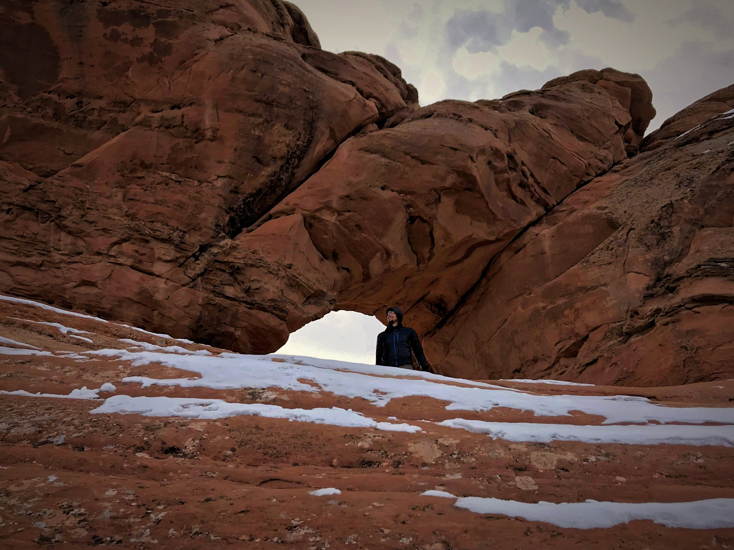 Ian stands inside Frame Arch, on the Delicate Arch trail.