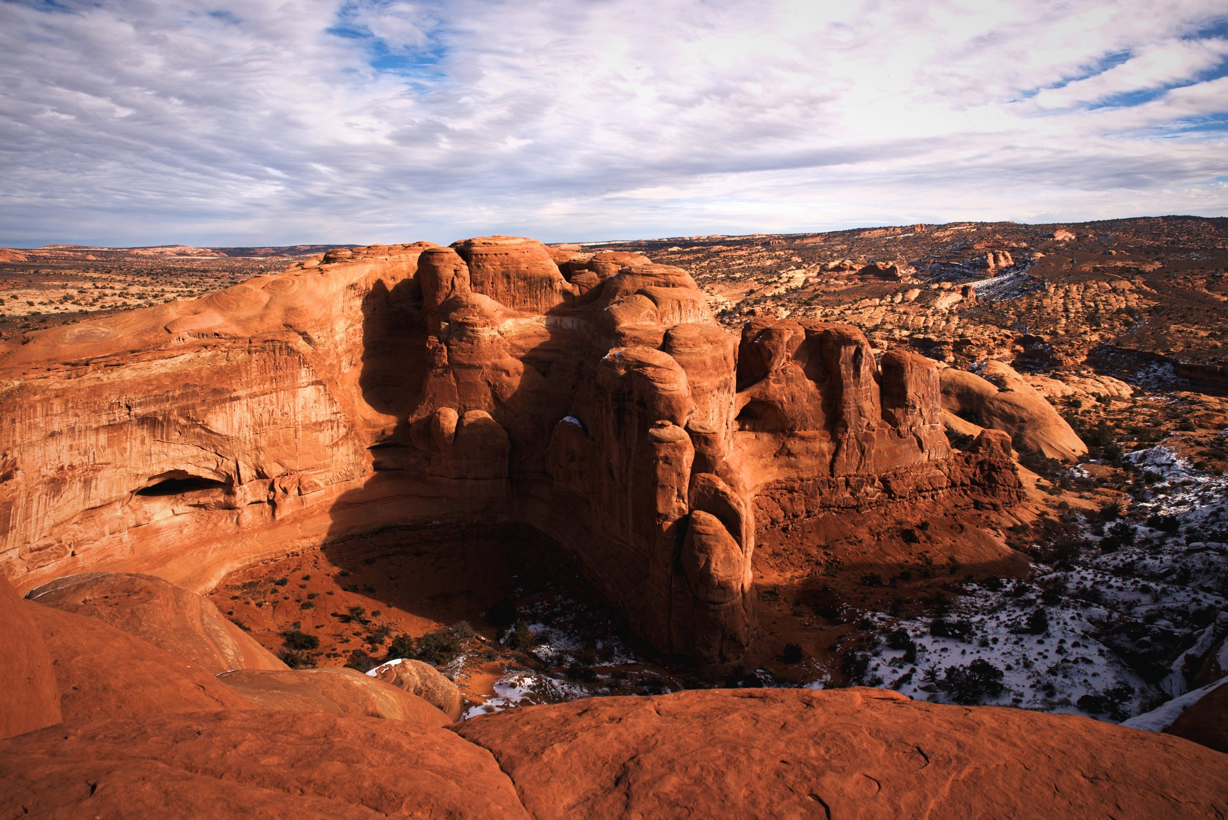 If you look into the sandstone formations around Delicate Arch, you may spot the beginnings of some future arches.