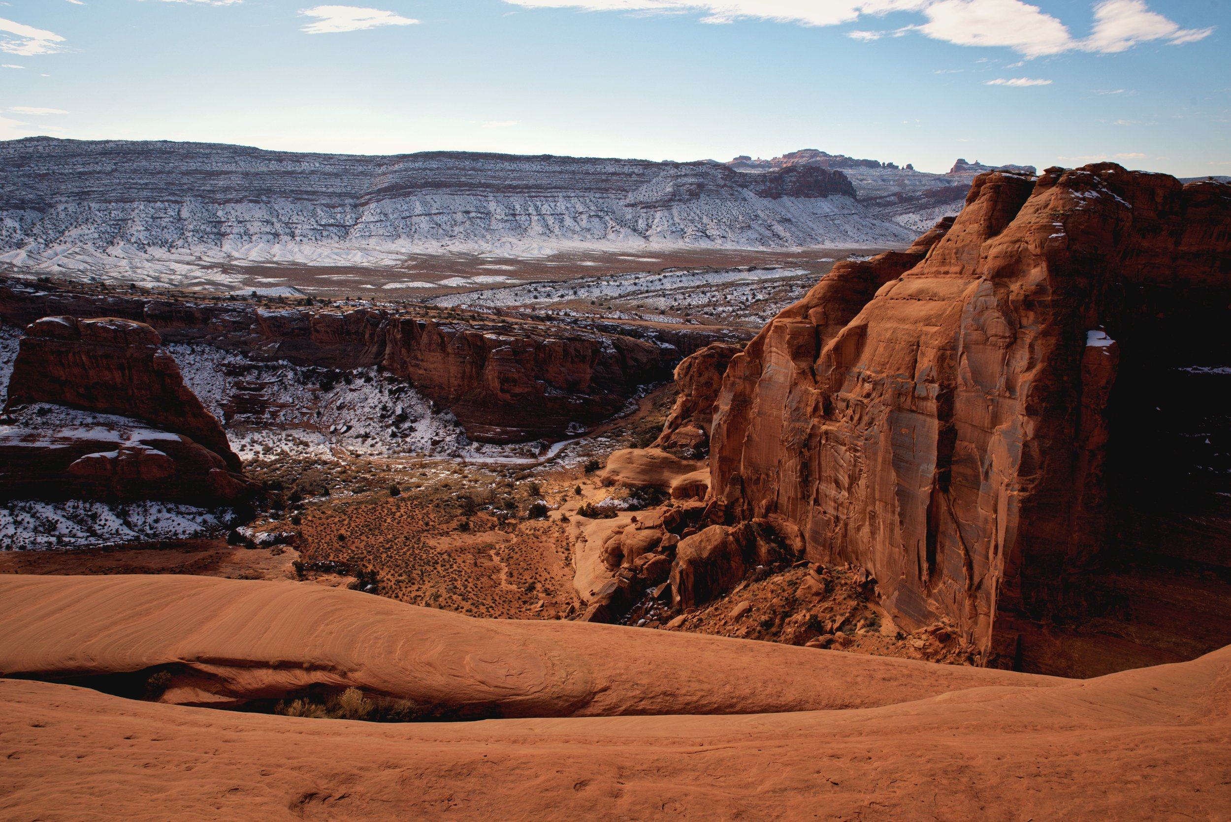 The trail to Delicate Arch has beautiful views along with the beautiful arch.