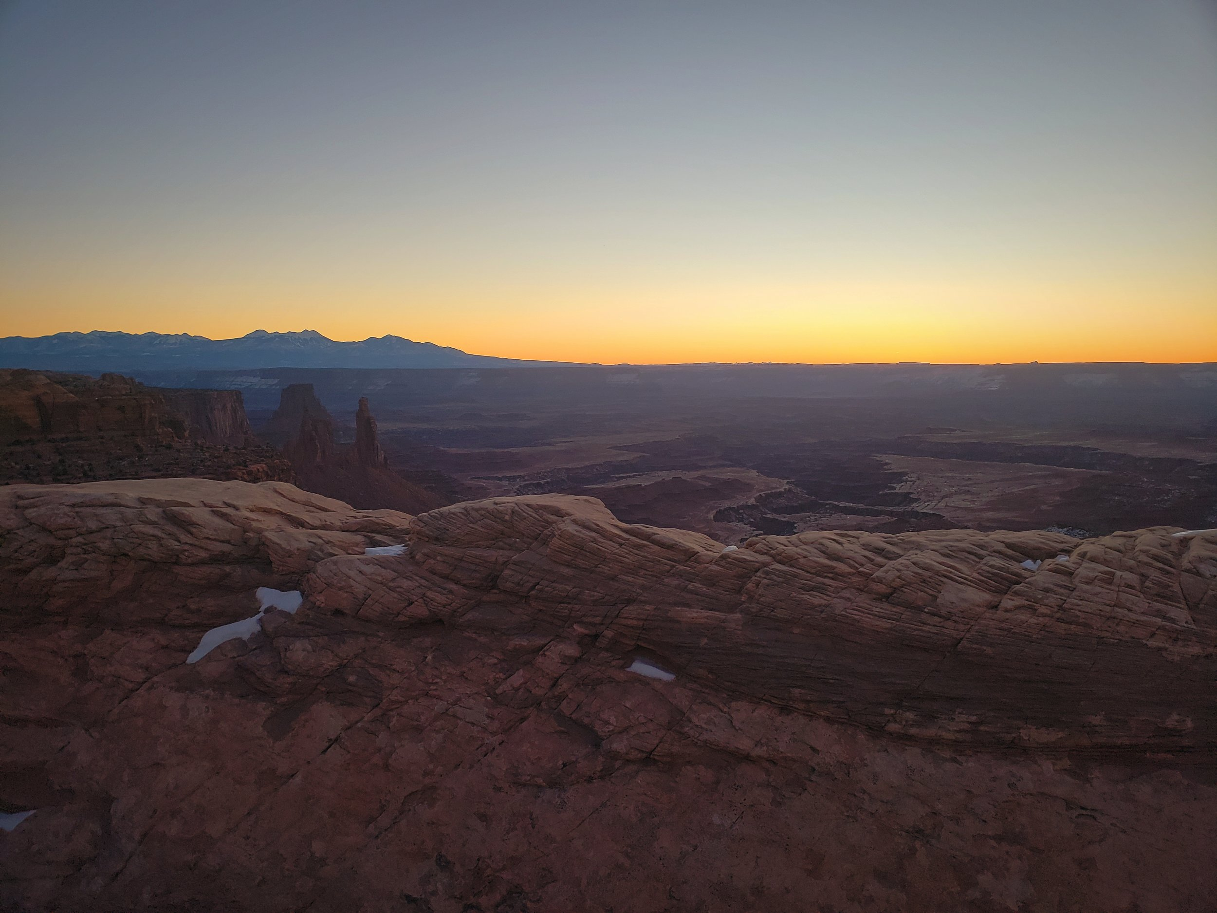 The gentle glow on the horizon before sunrise in Canyonlands.