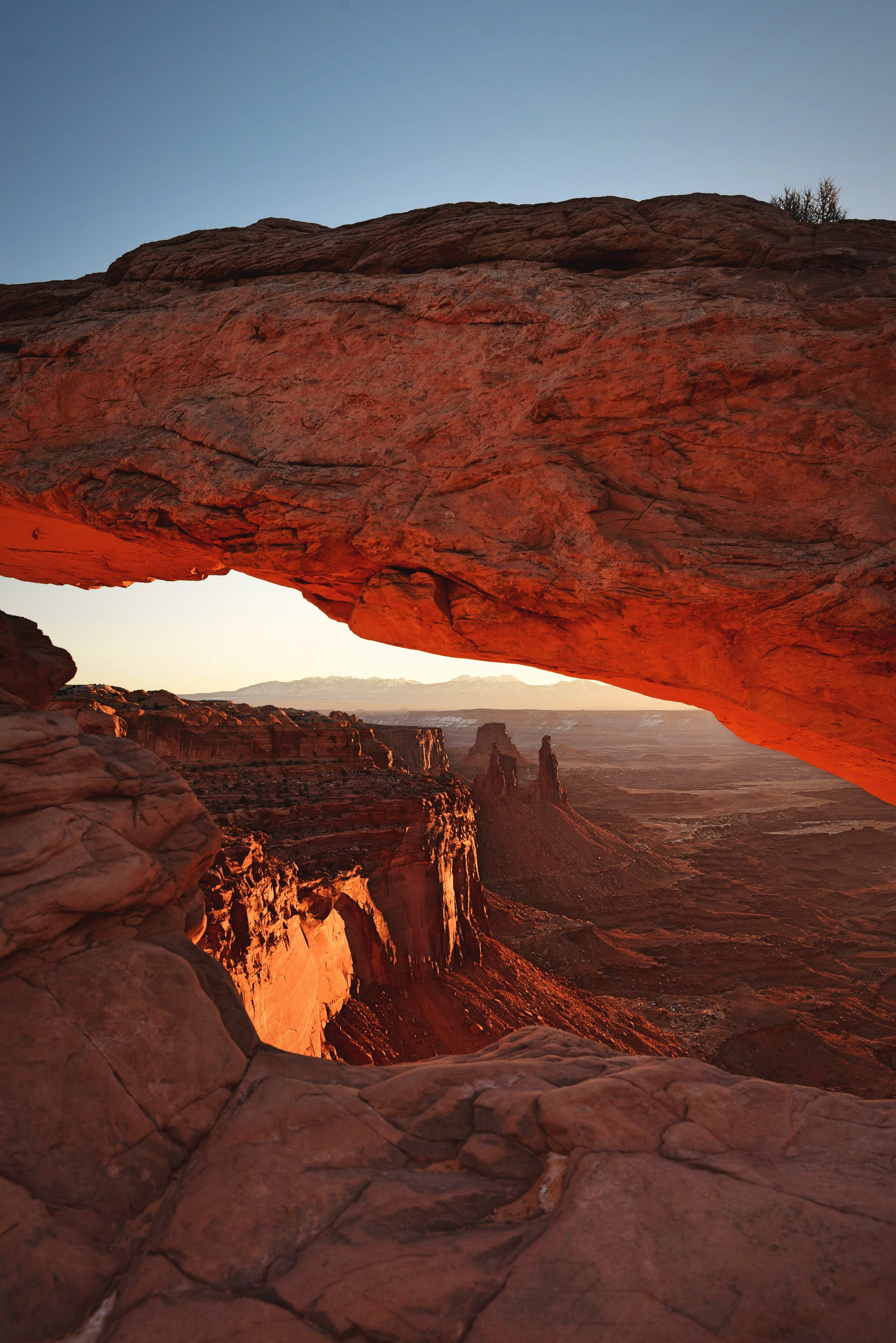 The sunrise turns the underside of Mesa Arch a beautiful red color.