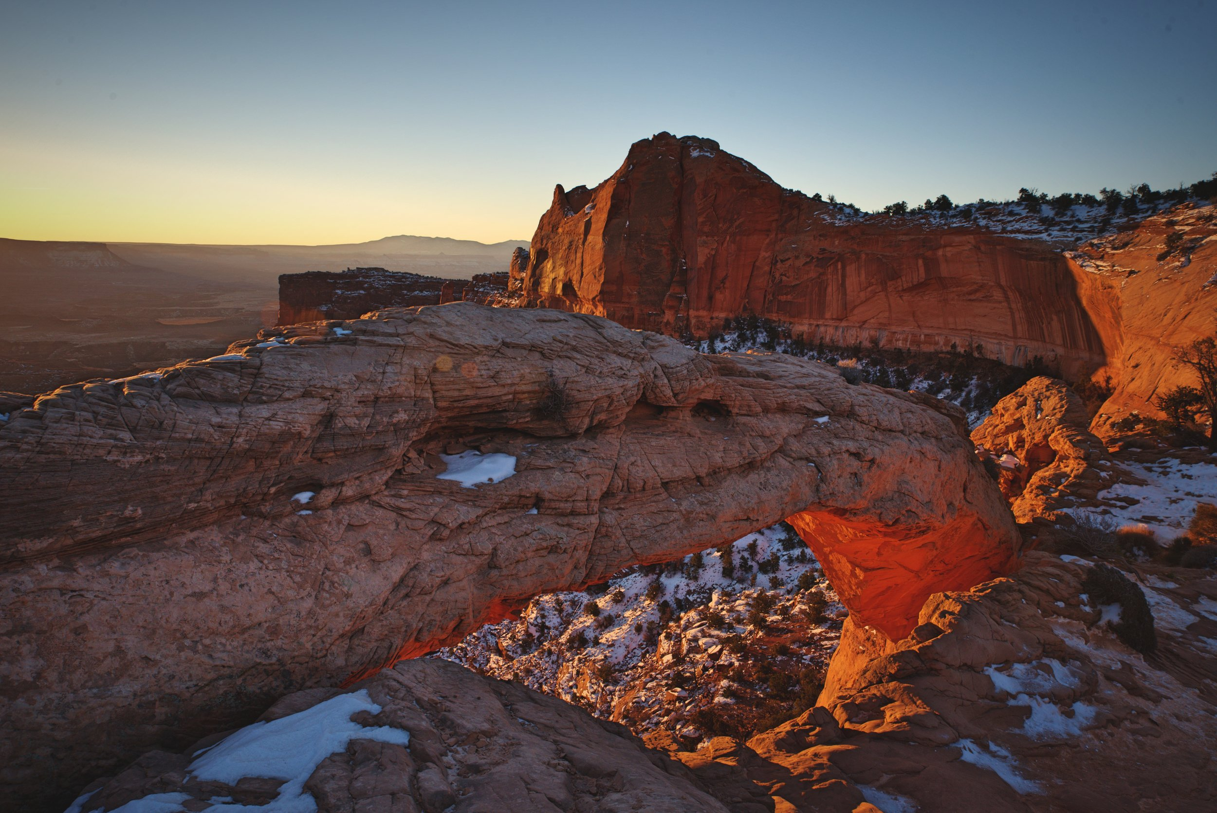 If you're planning to photograph Mesa Arch, walk around and try a few different compositions.