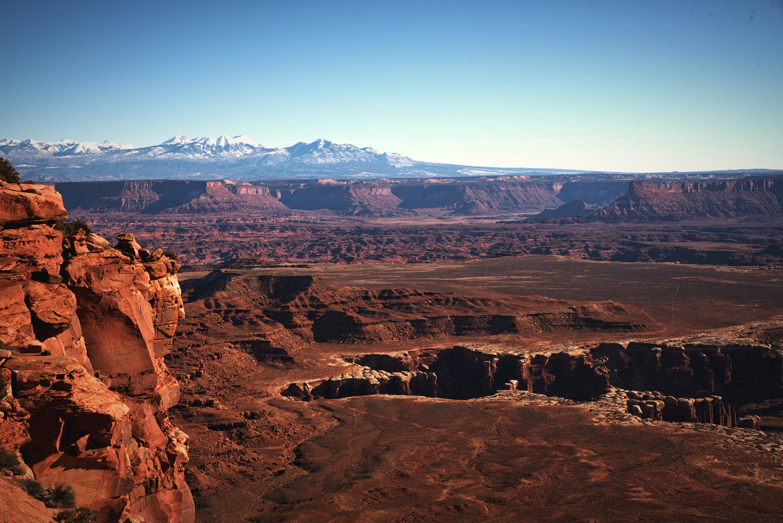 """Between here and there and me and the mountains it's the canyon wilderness, the hoodoo land of spire and pillar and pinnacle where no man lives, and where the river flows, unseen, through the blue-black trenches in the rock."" -Edward Abbey, writing about Canyonlands."