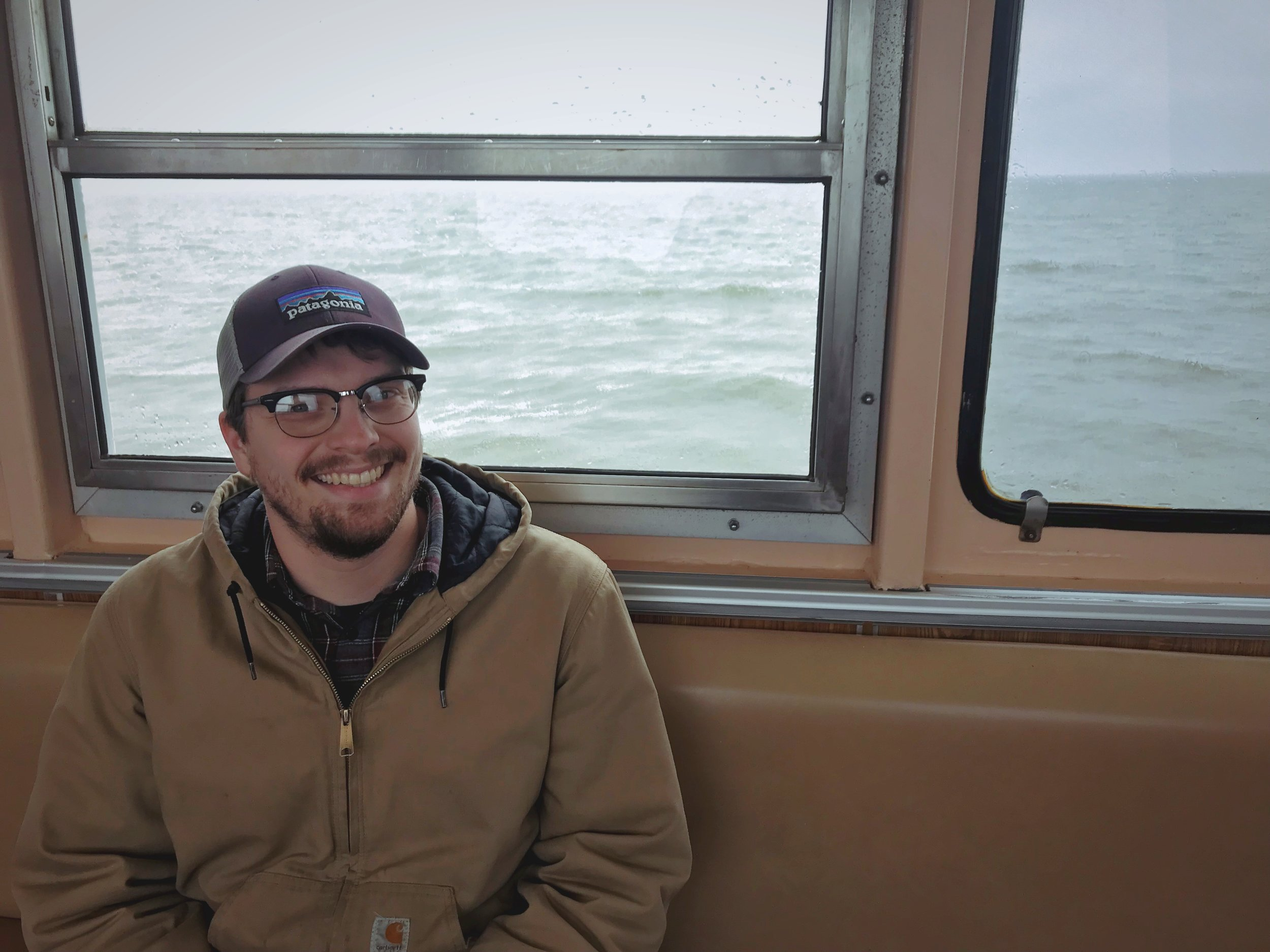 Ian sitting in the passenger lounge of the Ocracoke Ferry.