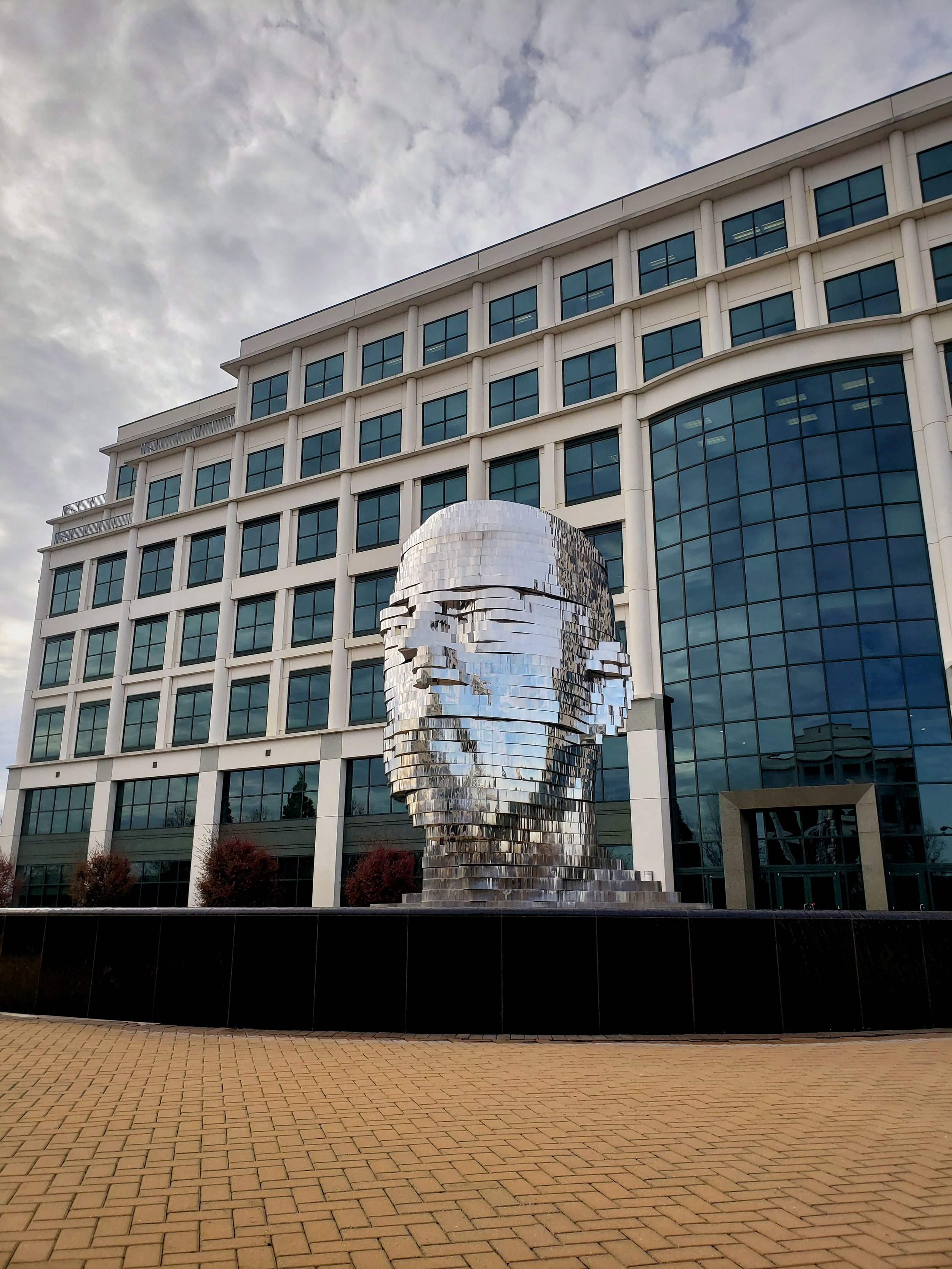 You might feel like you are headed in the wrong direction when looking for Metalmorphosis, because this stunning sculpture is in the middle of a financial park.