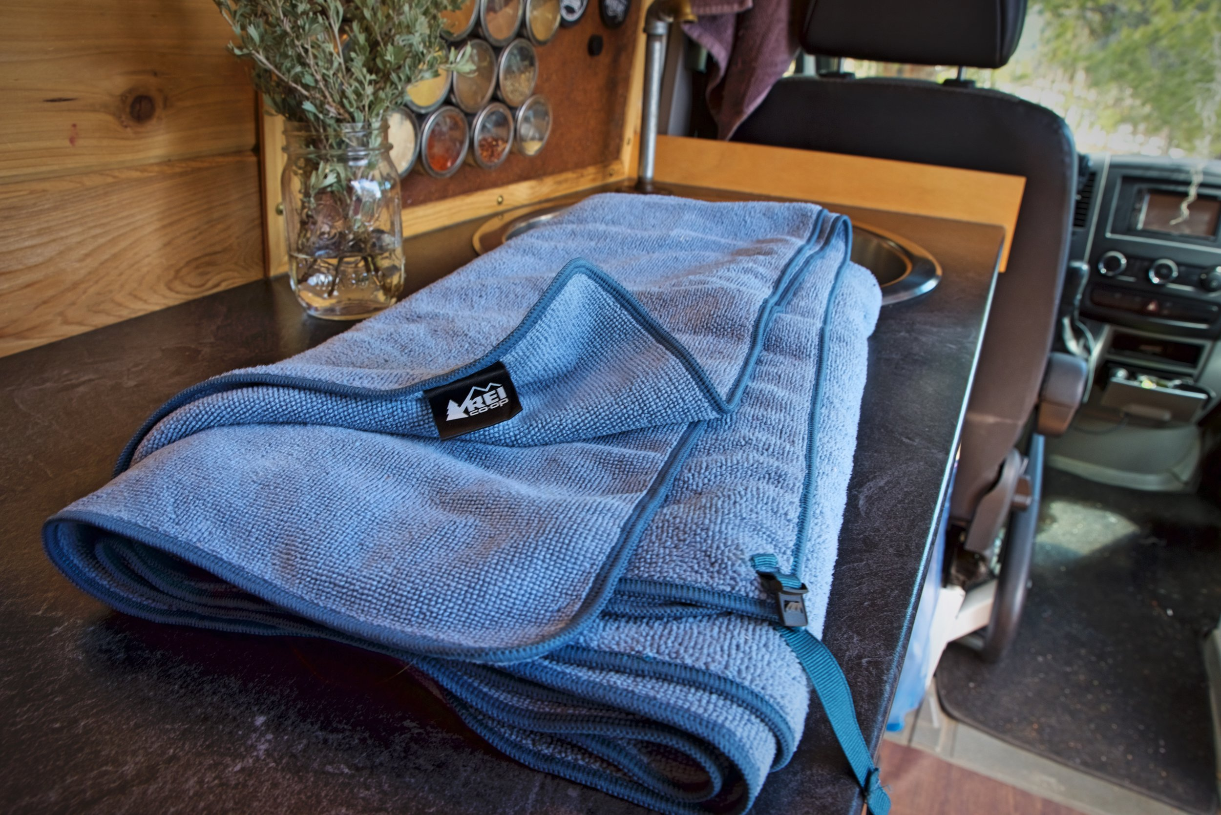Make sure to keep a towel nearby so that you clean up any water that doesn't make it to the sink. We like these camp towels for Vanlife, because they dry really quickly.