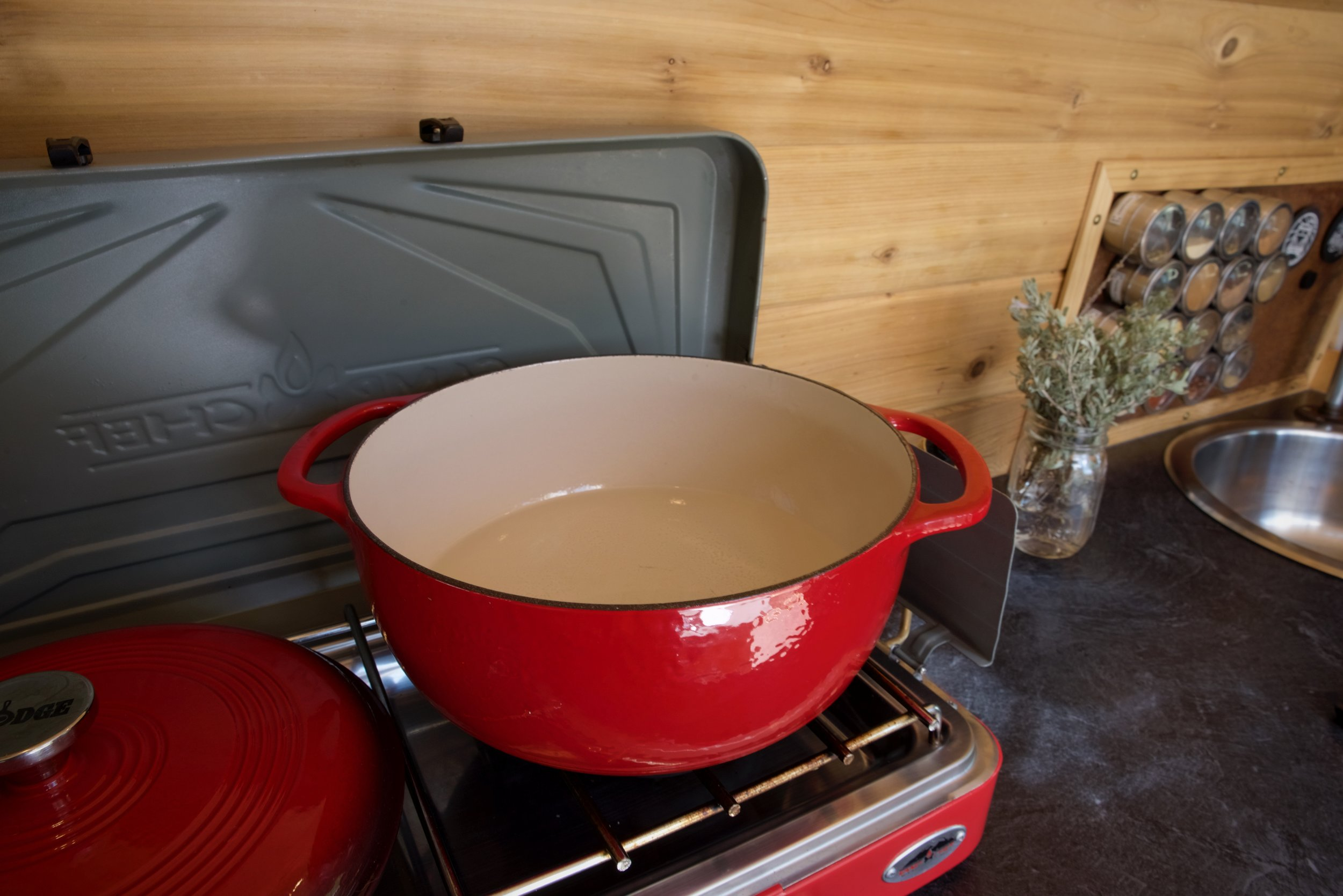 We use our big enamelware pot to wash our hair while living in our van.